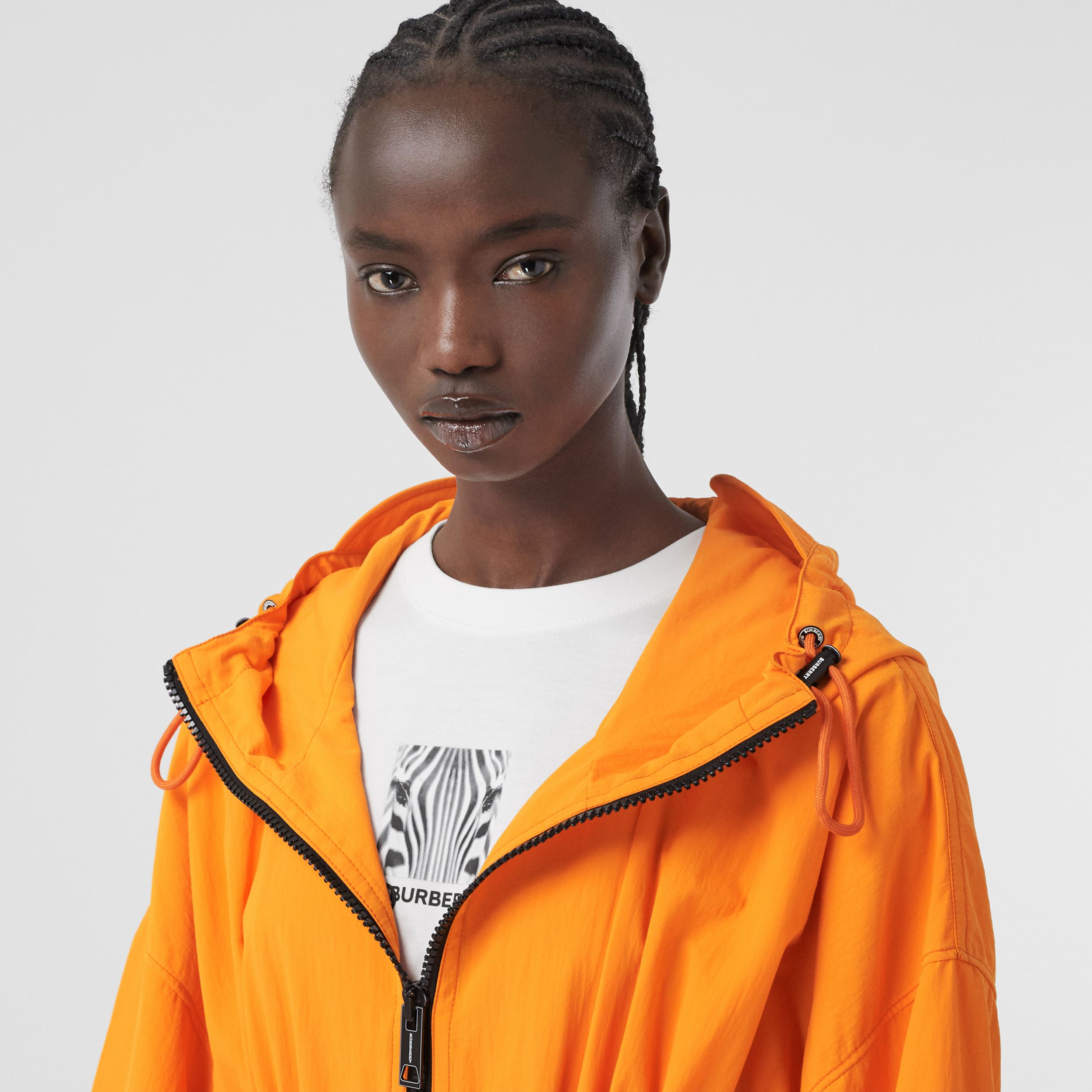 Logo Tape Technical Nylon Hooded Jacket in Bright Orange - Women | Burberry - 2