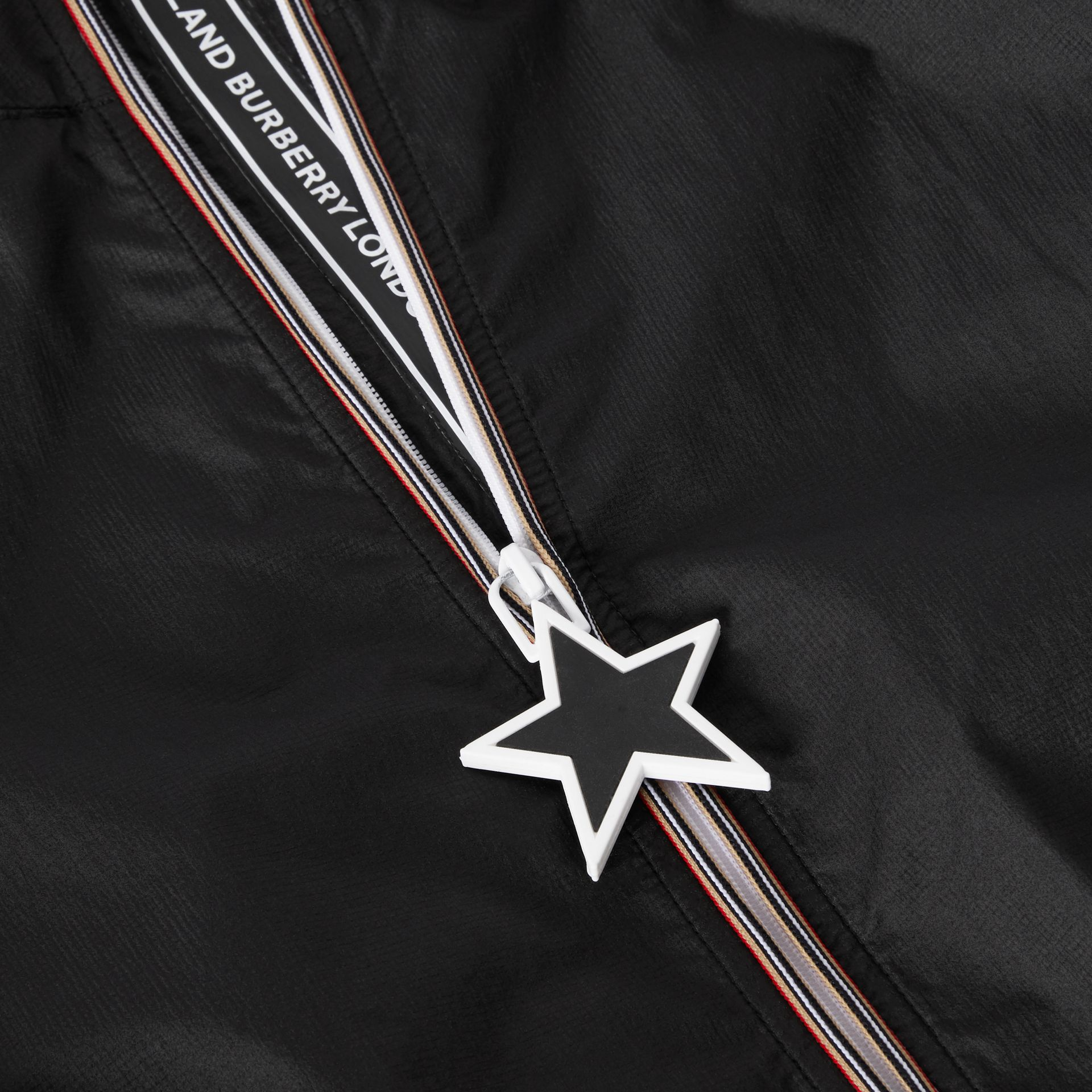 Star Detail Logo Print Lightweight Hooded Jacket in Black | Burberry United States - gallery image 1