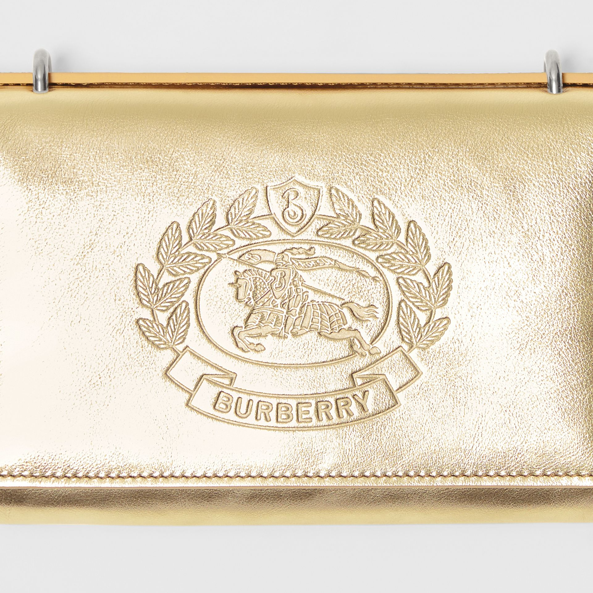 Embossed Crest Metallic Leather Wallet with Detachable Strap in Gold - Women | Burberry United States - gallery image 1