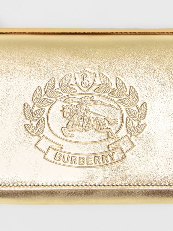 Embossed Crest Metallic Leather Wallet with Detachable Strap in Gold - Women | Burberry United States - cell image 1