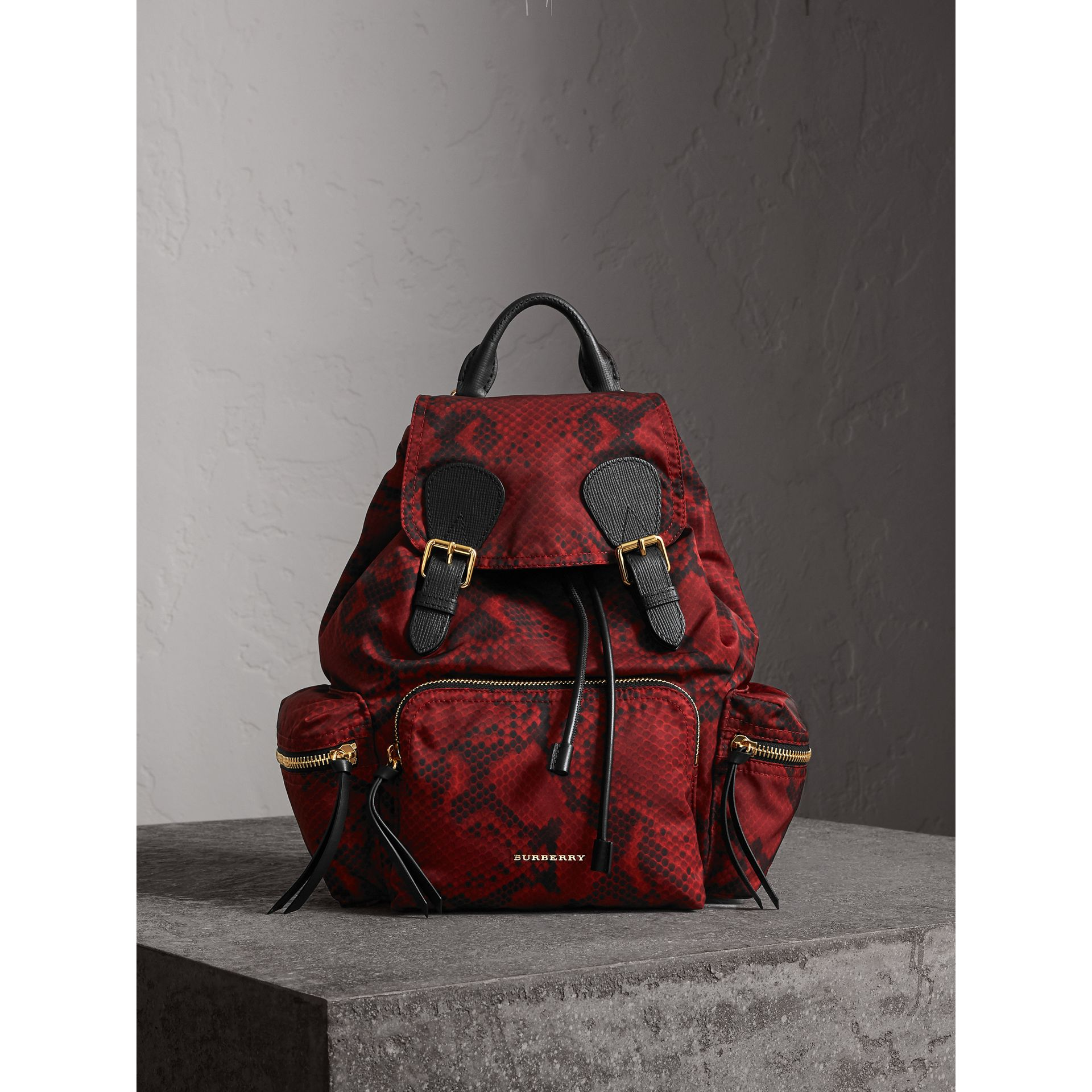 The Medium Rucksack in Python Print Nylon and Leather in Burgundy Red - gallery image 1
