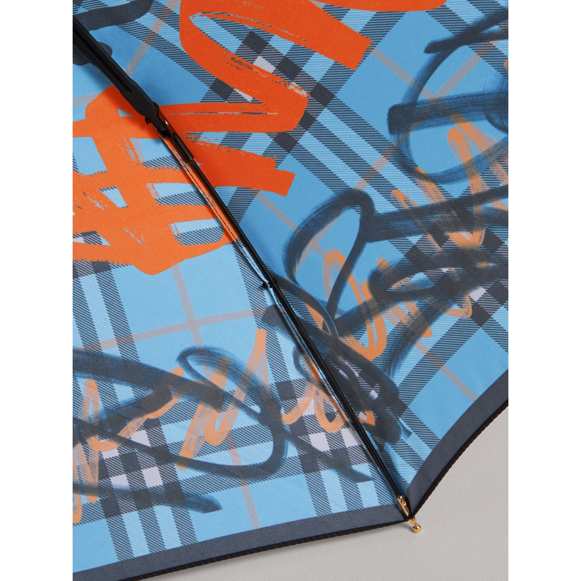 Graffiti Check Folding Umbrella in Light Azure | Burberry - gallery image 2
