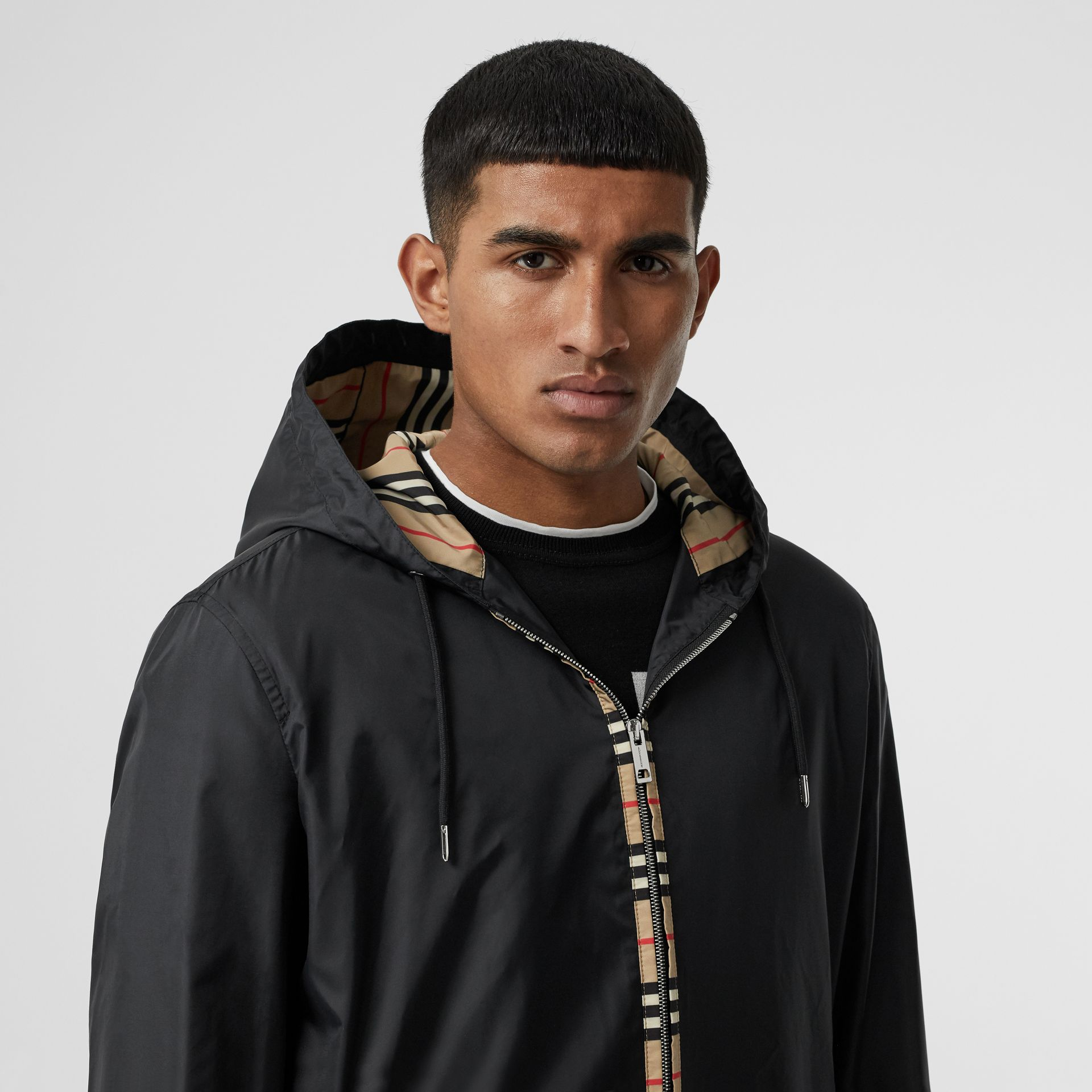 Icon Stripe Detail Nylon Canvas Hooded Jacket in Black - Men | Burberry Canada - gallery image 1
