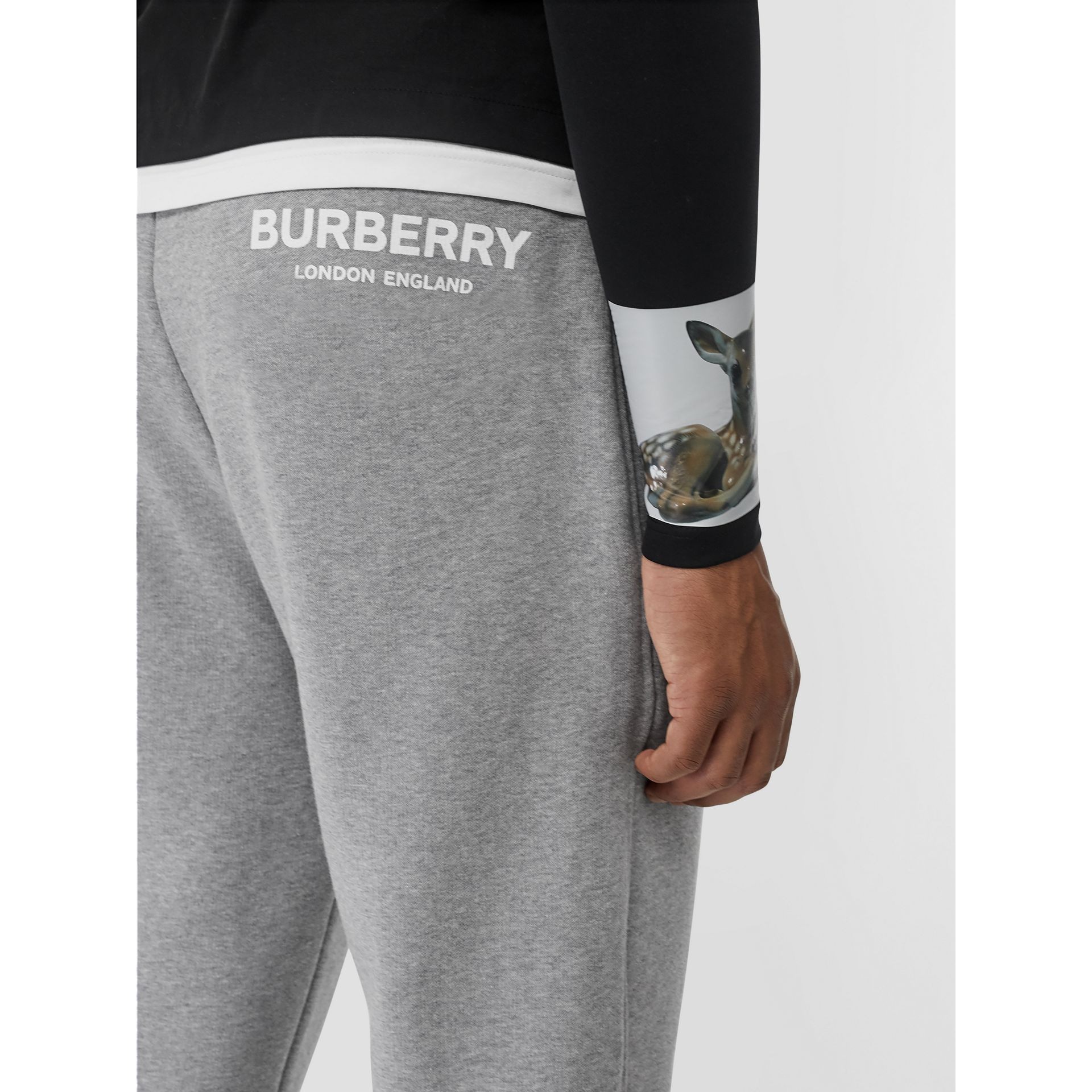 Logo Print Cotton Trackpants in Pale Grey Melange - Men | Burberry Singapore - gallery image 1
