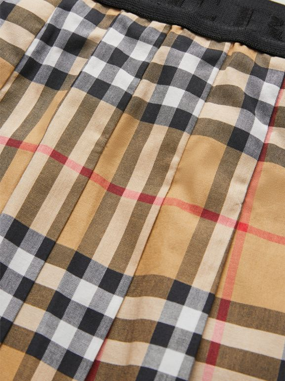 Pleated Vintage Check Cotton Skirt in Antique Yellow - Girl | Burberry - cell image 1