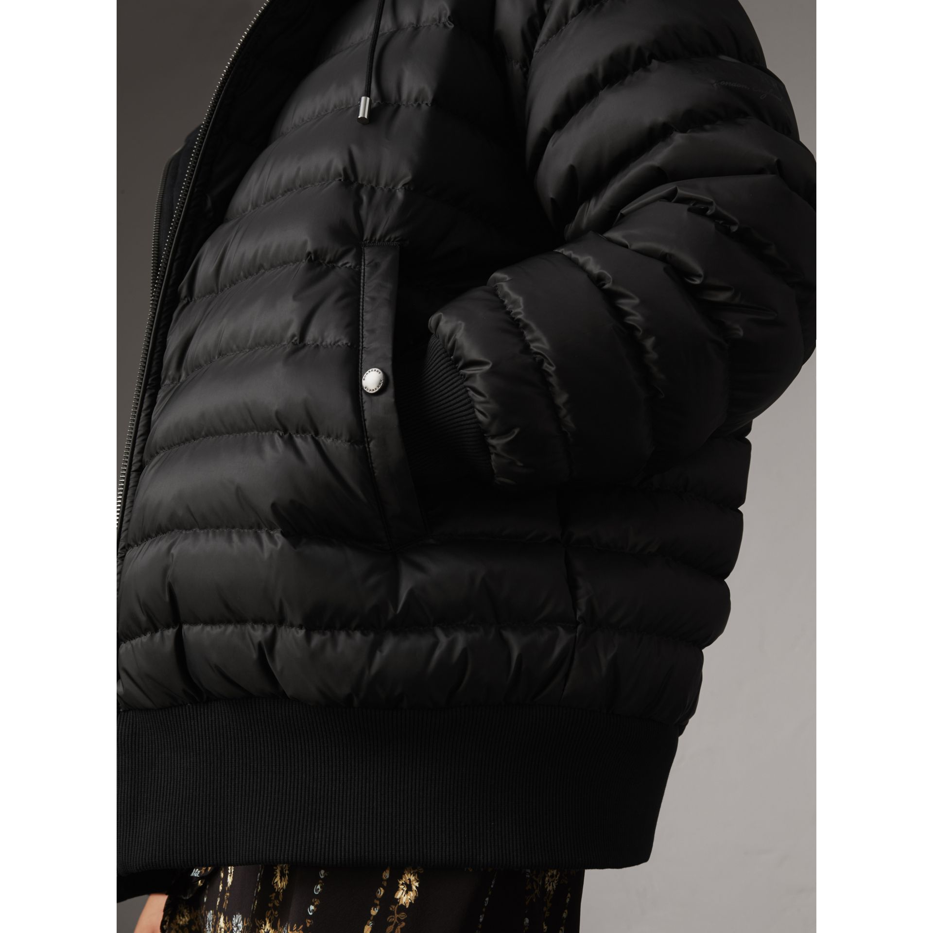 Reversible Down-filled Hooded Bomber Jacket in Black - Women | Burberry - gallery image 1