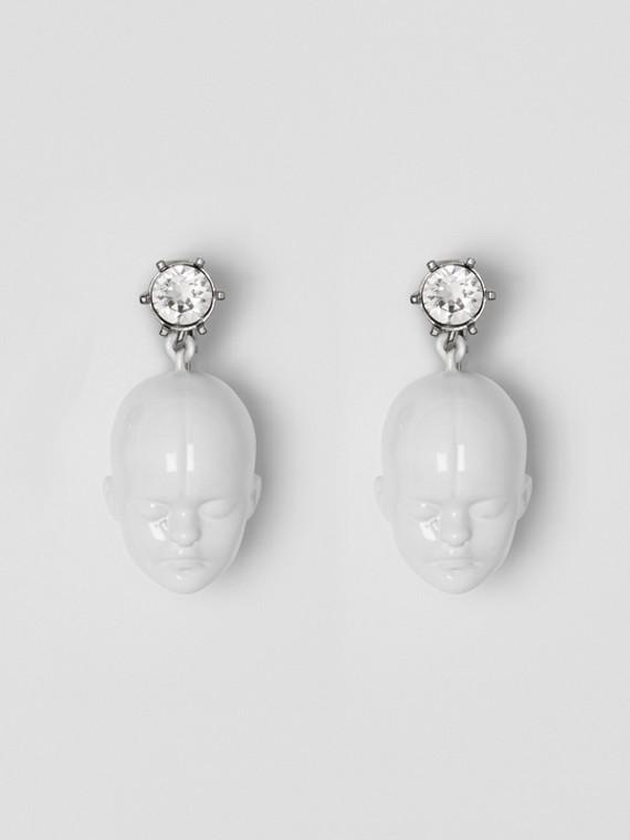 Boucles d'oreilles plaquées palladium avec tête de poupée et cristal (Blanc/palladium)