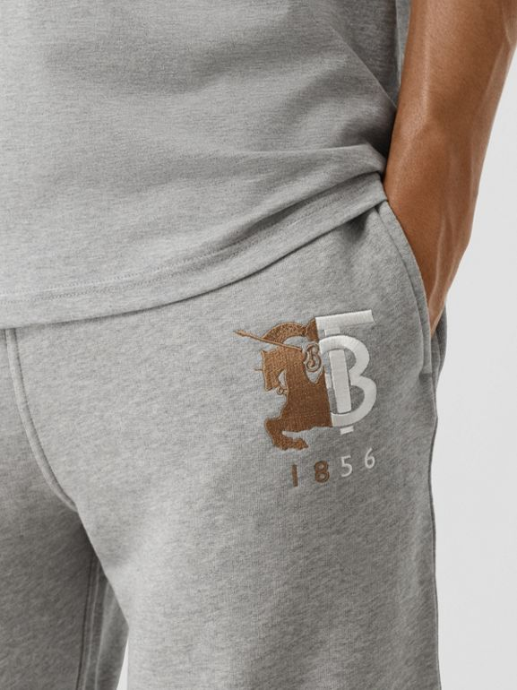 Contrast Logo Graphic Cotton Trackpants in Pale Grey Melange - Men | Burberry United Kingdom - cell image 1