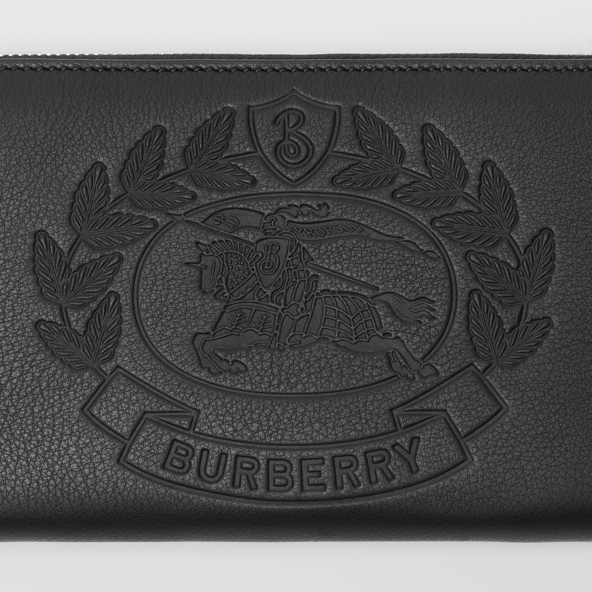 Embossed Crest Leather Ziparound Wallet in Black - Men | Burberry - gallery image 1