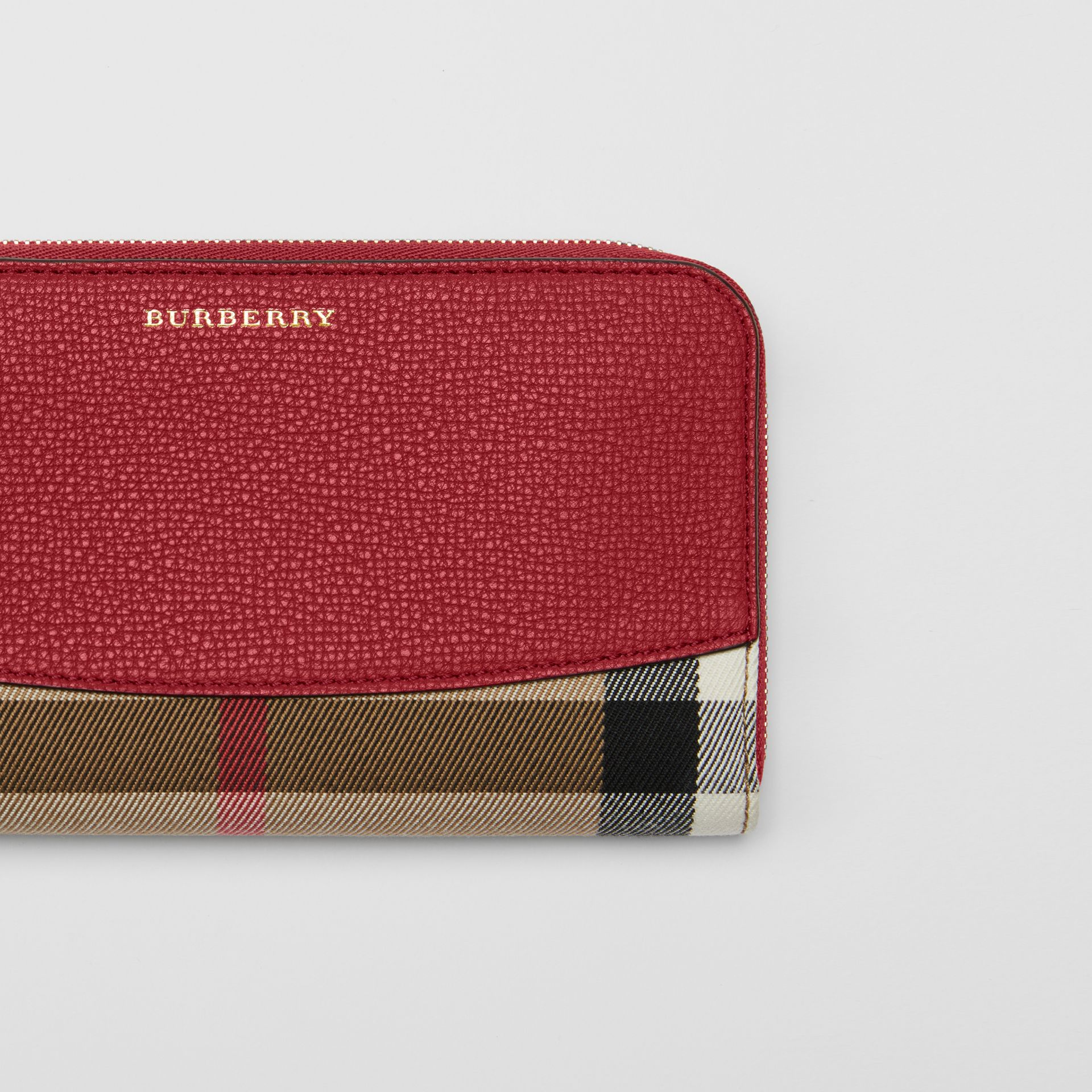 House Check and Leather Ziparound Wallet in Russet Red - Women | Burberry United Kingdom - gallery image 1