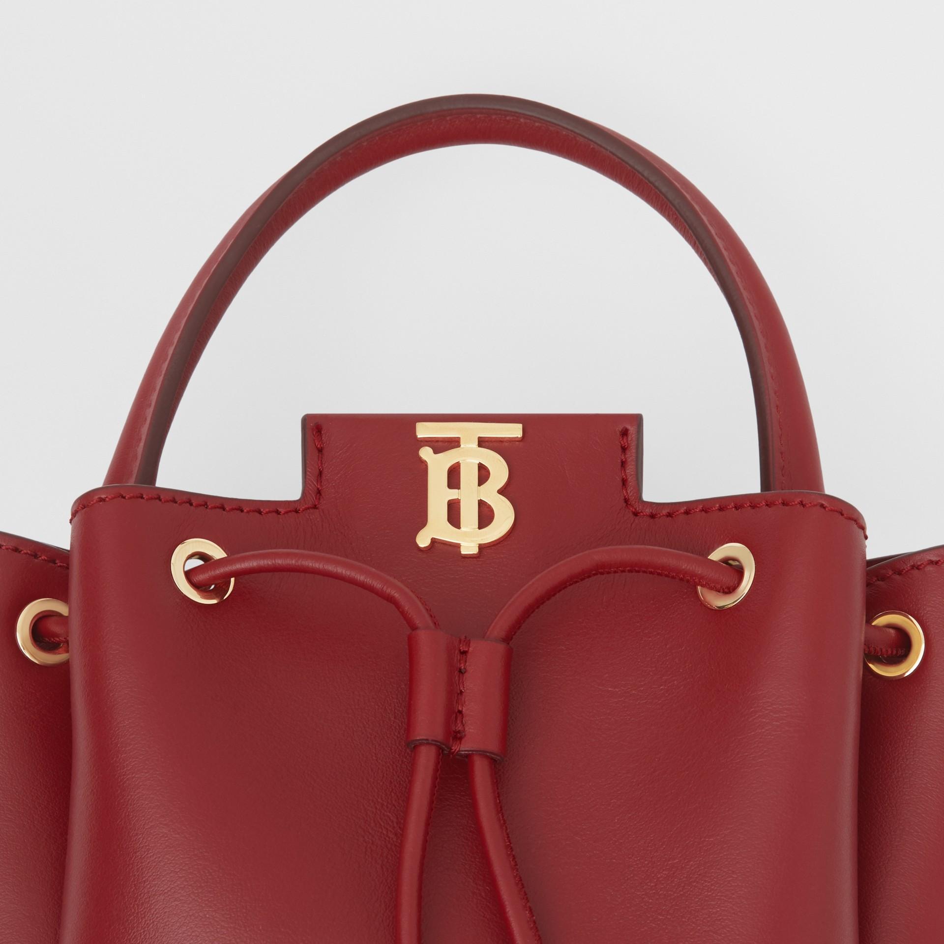 Monogram Motif Leather Bucket Bag in Dark Carmine - Women | Burberry United States - gallery image 1