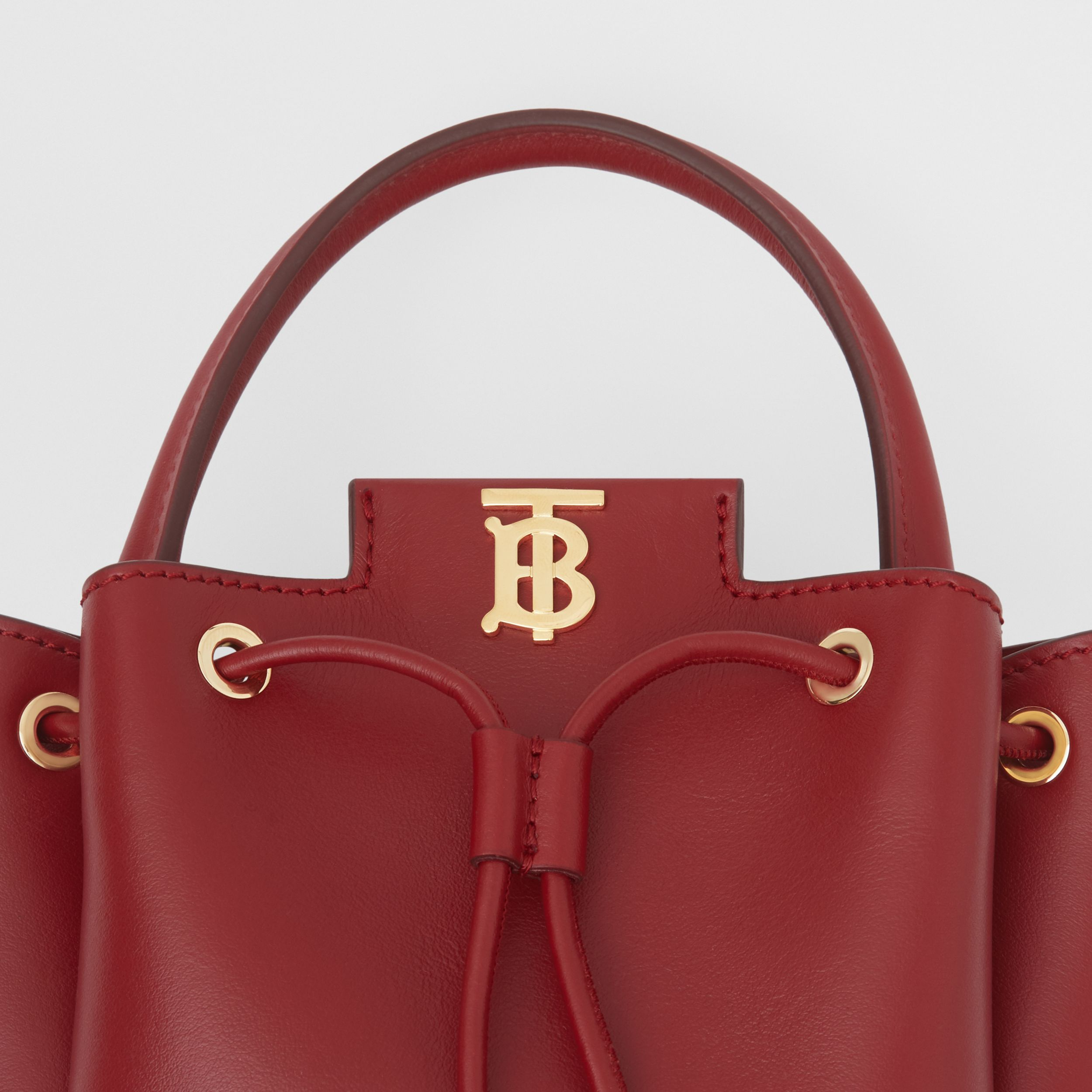 Monogram Motif Leather Bucket Bag in Dark Carmine - Women | Burberry - 2