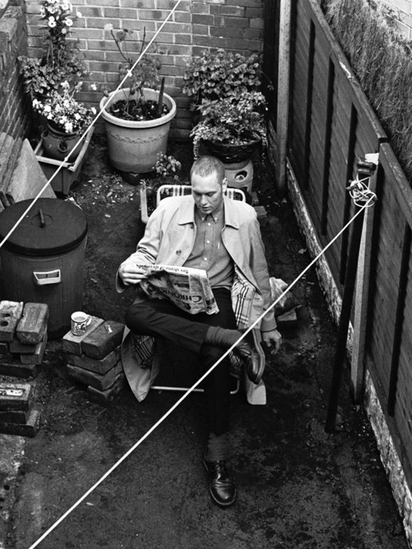 Sam Batley, reading the morning paper in grandma's back garden, Barnsley, wearing The Car Coat.