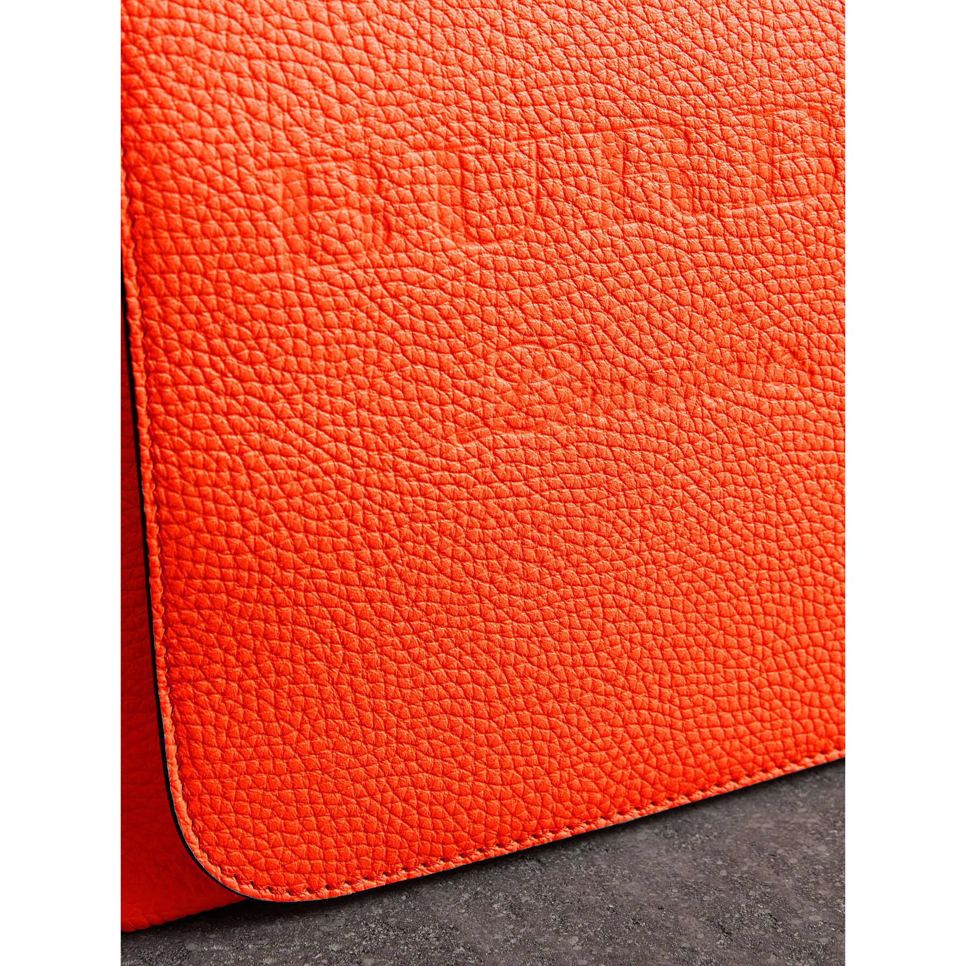 Large Embossed Leather Messenger Bag in Neon Orange | Burberry - gallery image 1