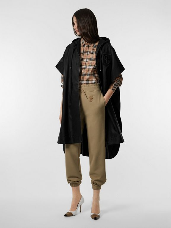 Monogram Motif Nylon Oversized Hooded Poncho in Black | Burberry - cell image 1