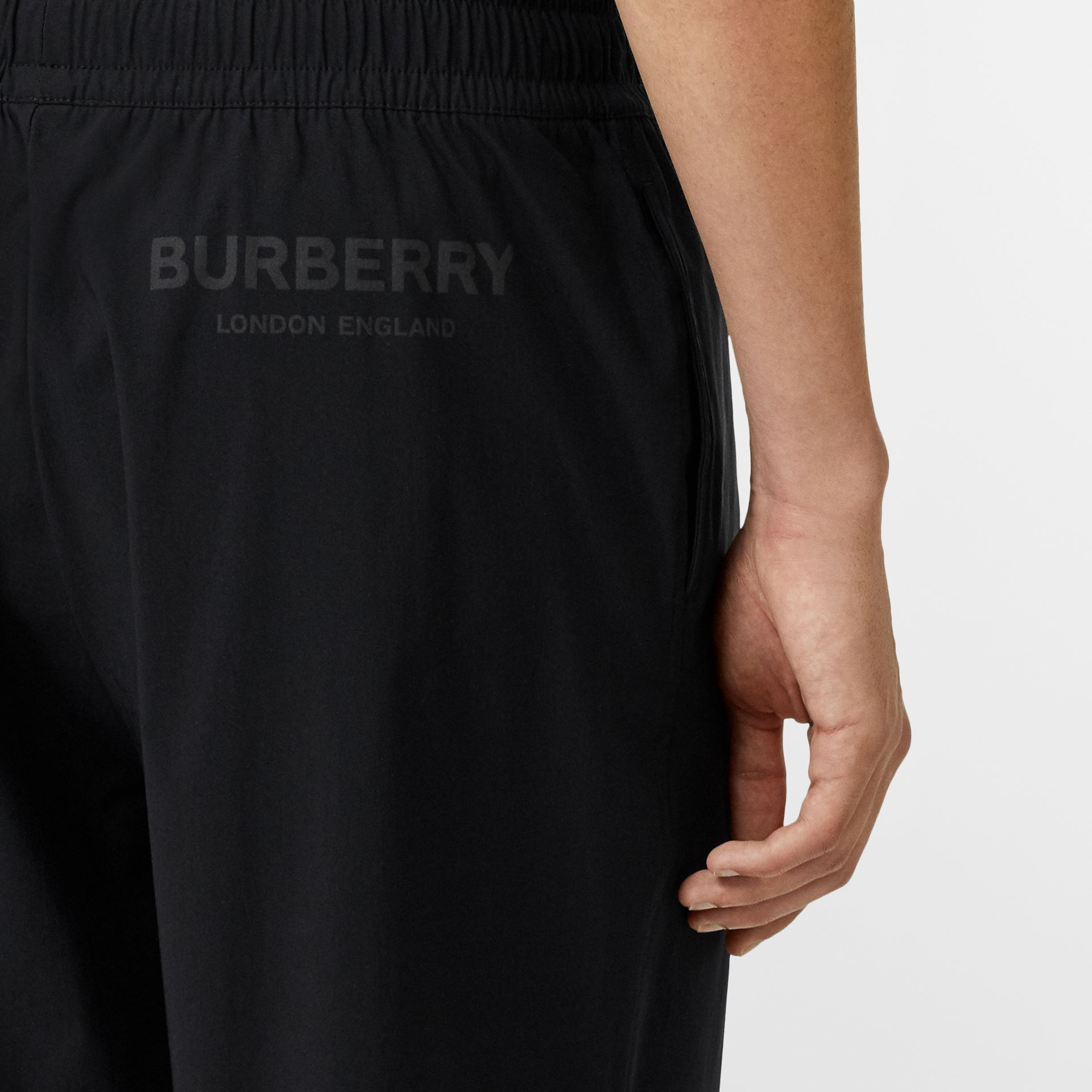 Logo Print Stretch Nylon Shorts in Black - Men | Burberry Canada - gallery image 1