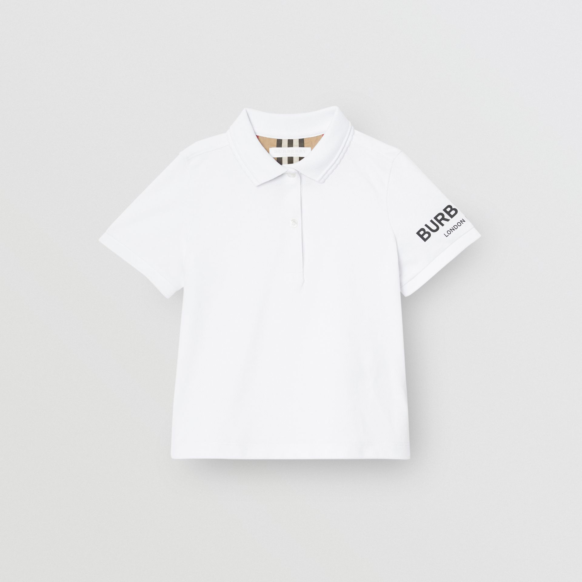 Logo Print Cotton Piqué Polo Shirt in White | Burberry - gallery image 0