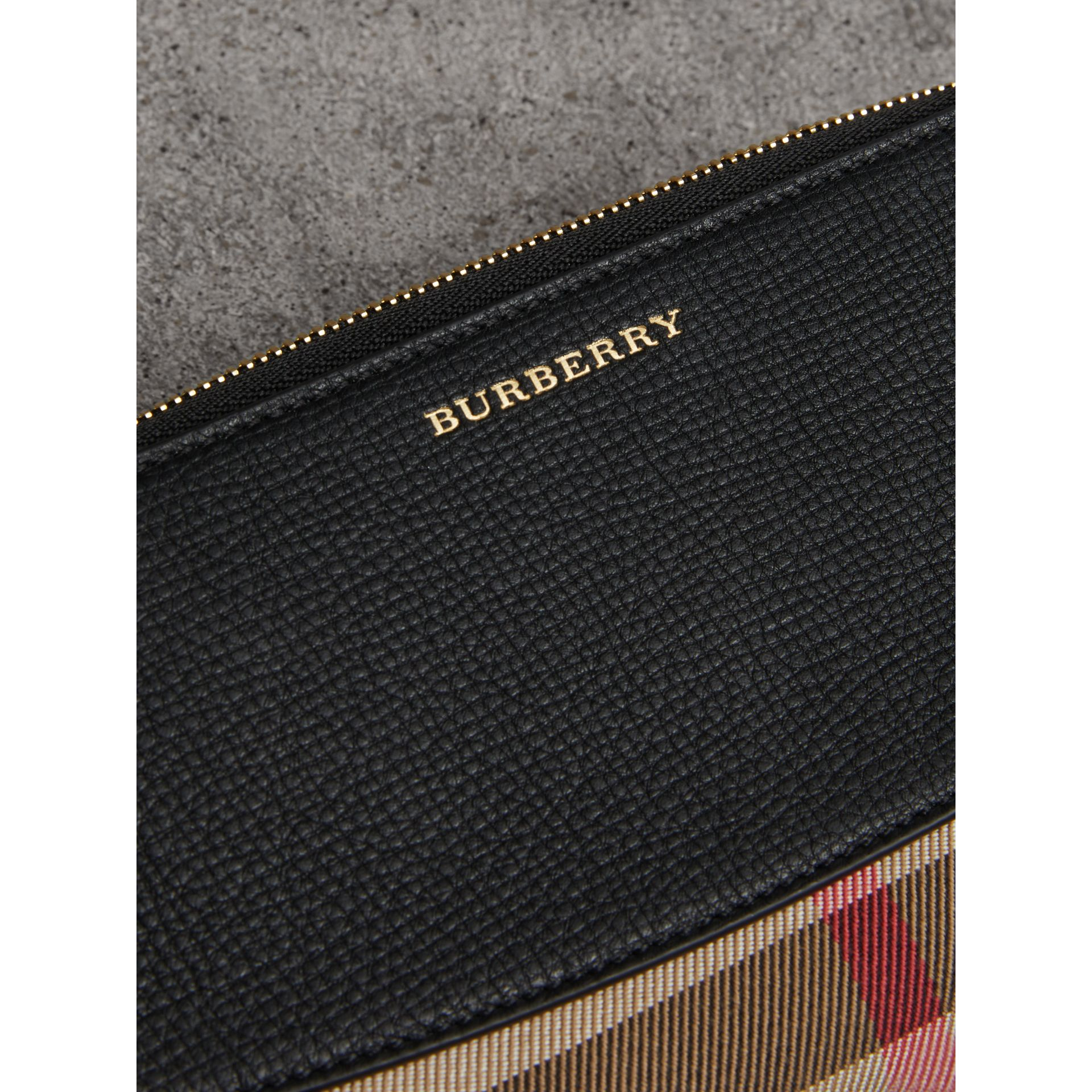 House Check and Leather Ziparound Wallet in Black - Women | Burberry United Kingdom - gallery image 1