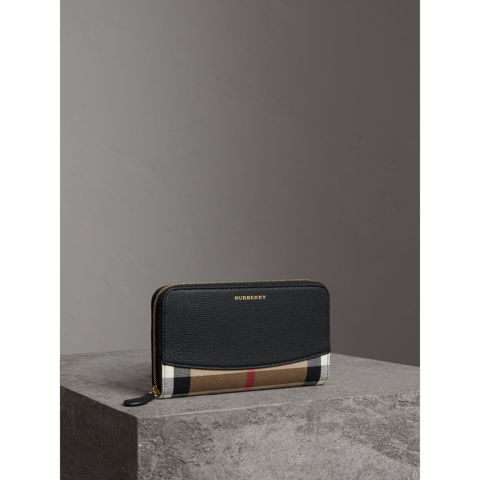 House Check and Leather Ziparound Wallet in Black - Women | Burberry - gallery image 1