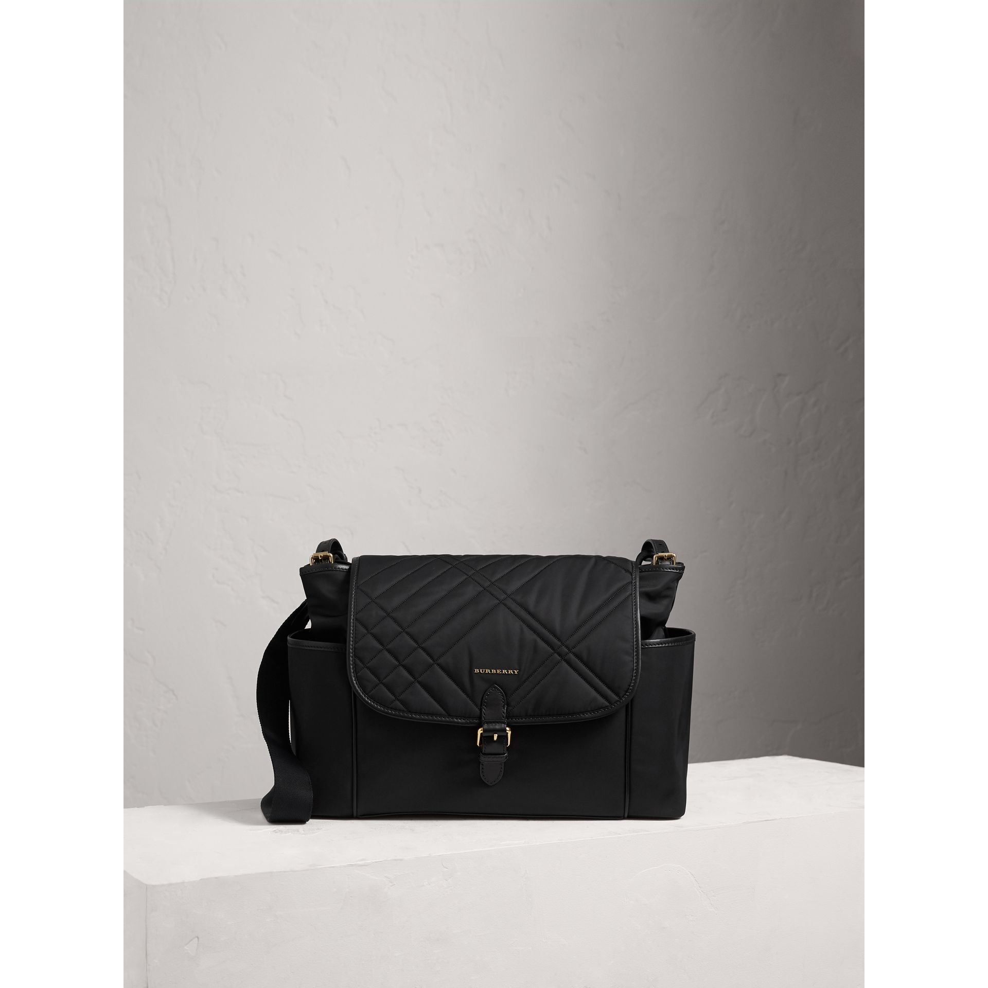 Check-quilted Baby Changing Shoulder Bag in Black | Burberry - gallery image 1