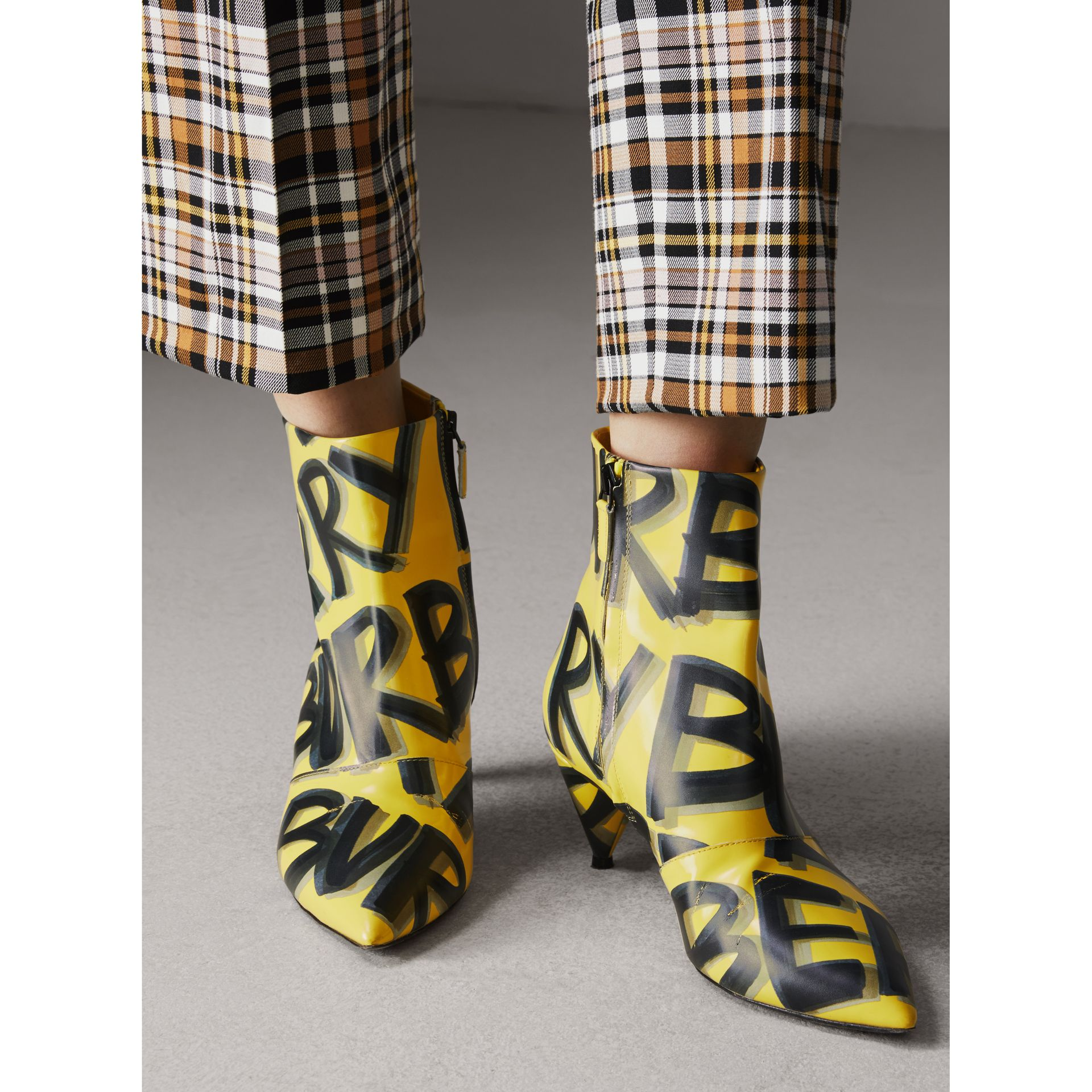 Graffiti Print Leather Ankle Boots in Vibrant Yellow - Women | Burberry Singapore - gallery image 2