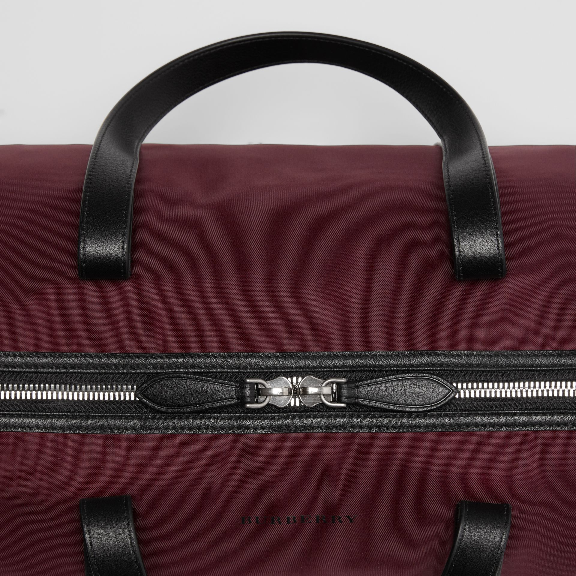 Medium Nylon and Vintage Check Barrel Bag in Oxblood - Men | Burberry - gallery image 1