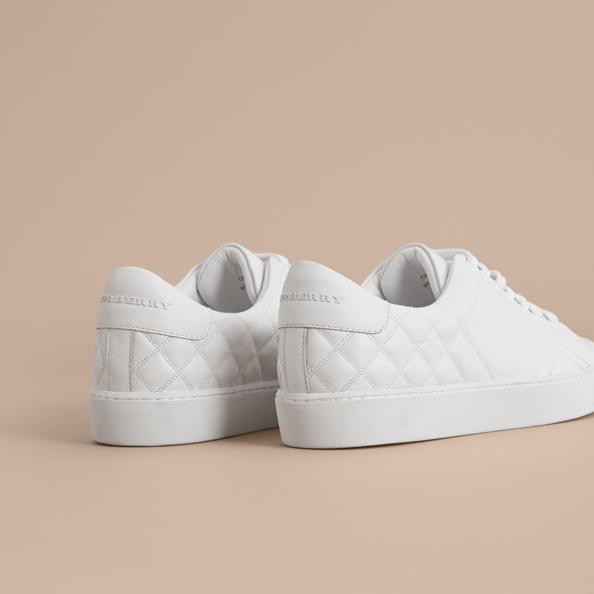 Check-quilted Leather Trainers in Optic White - Women | Burberry - gallery image 4