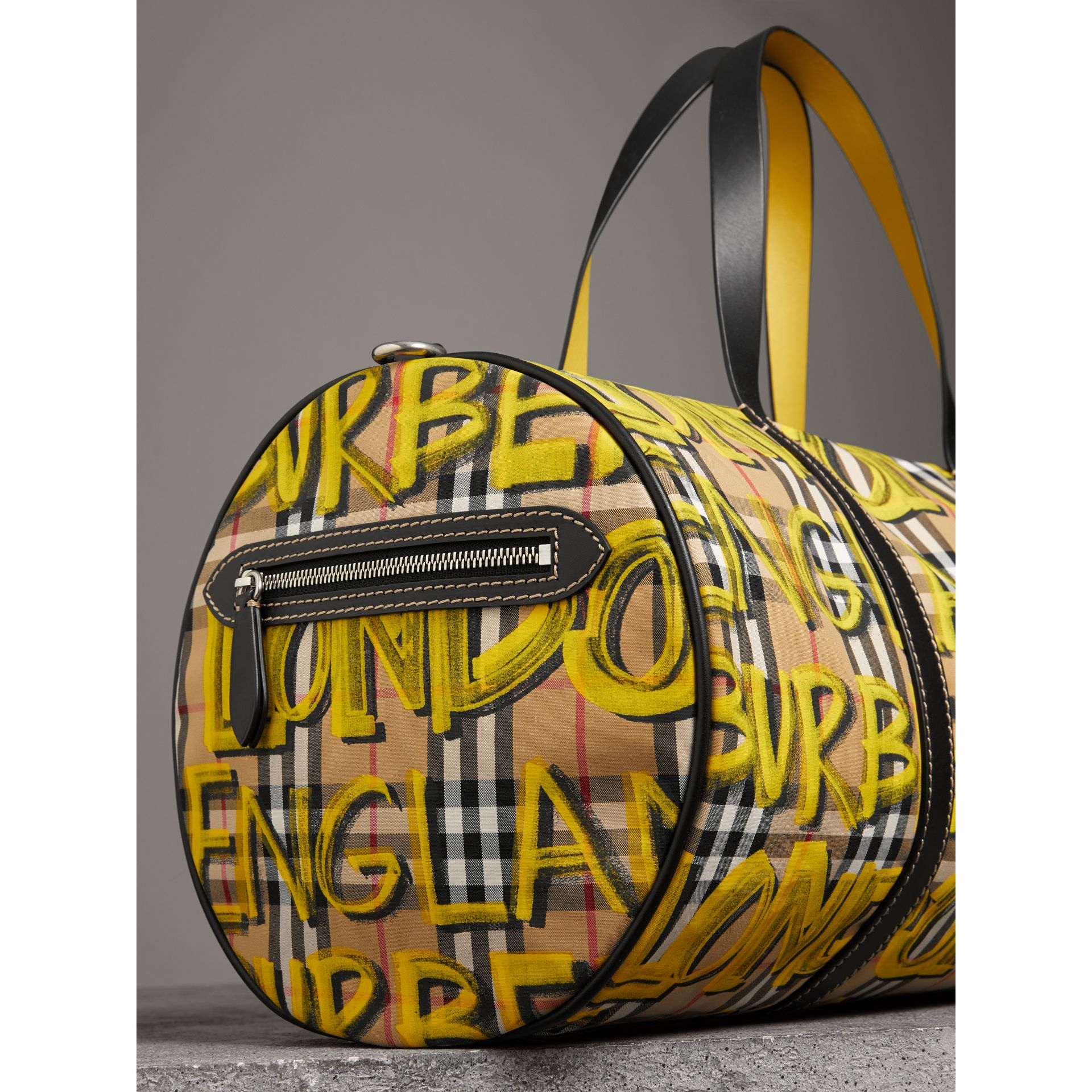 Medium Graffiti Print Vintage Check Barrel Bag in Bright Yellow/antique Yellow - Men | Burberry United States - gallery image 1