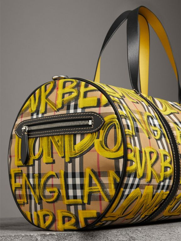 Medium Graffiti Print Vintage Check Barrel Bag in Bright Yellow/antique Yellow - Men | Burberry United States - cell image 1