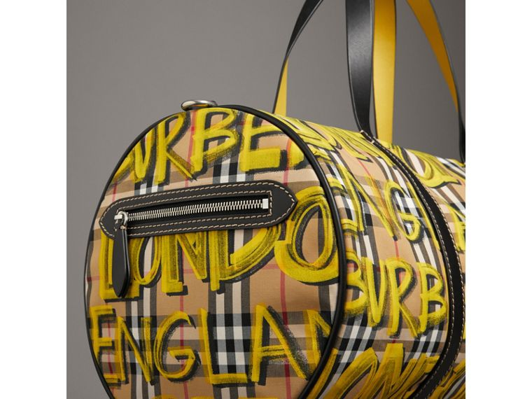 Medium Graffiti Print Vintage Check Barrel Bag in Bright Yellow/antique Yellow - Men | Burberry United Kingdom - cell image 1