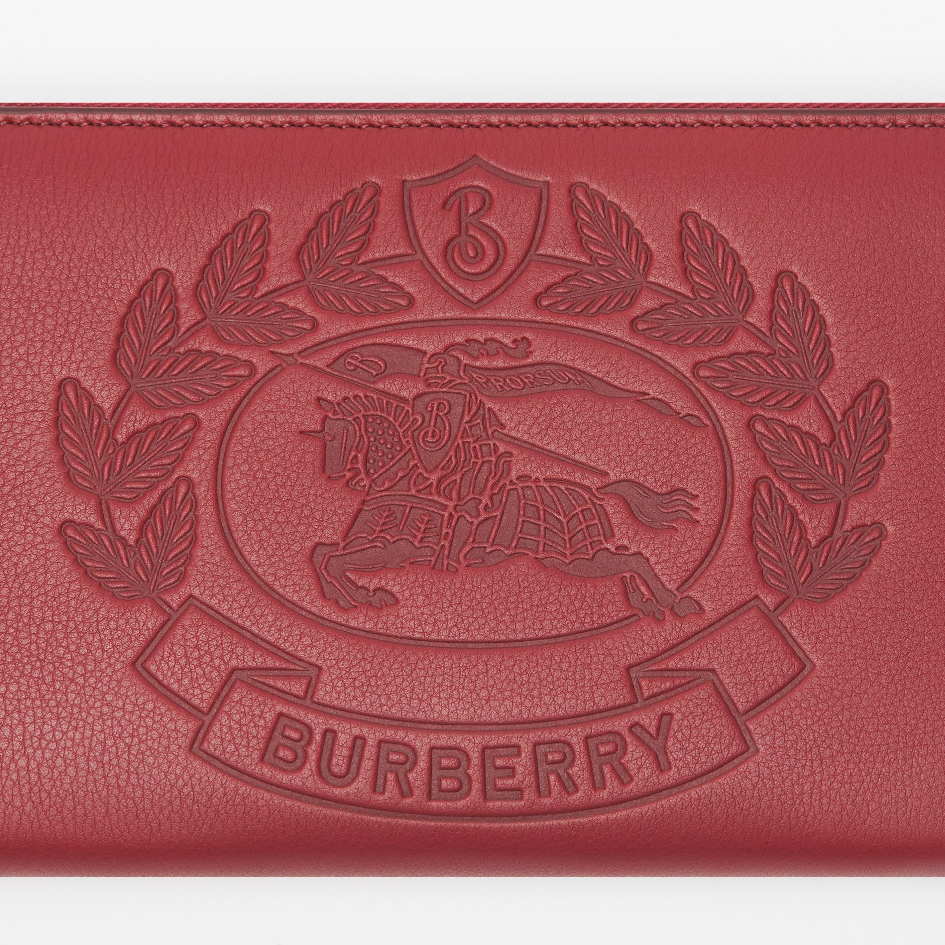 Embossed Crest Leather Ziparound Wallet in Crimson - Men | Burberry - gallery image 1