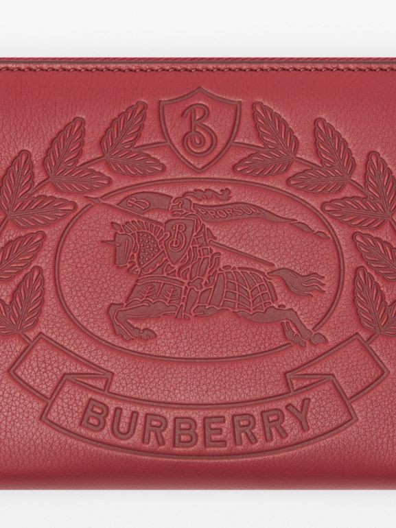 Embossed Crest Leather Ziparound Wallet in Crimson - Men | Burberry - cell image 1