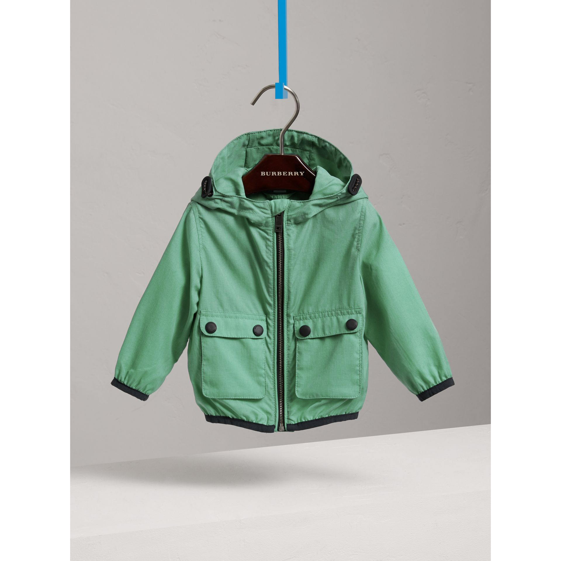 Showerproof Hooded Jacket in Vibrant Green | Burberry - gallery image 0
