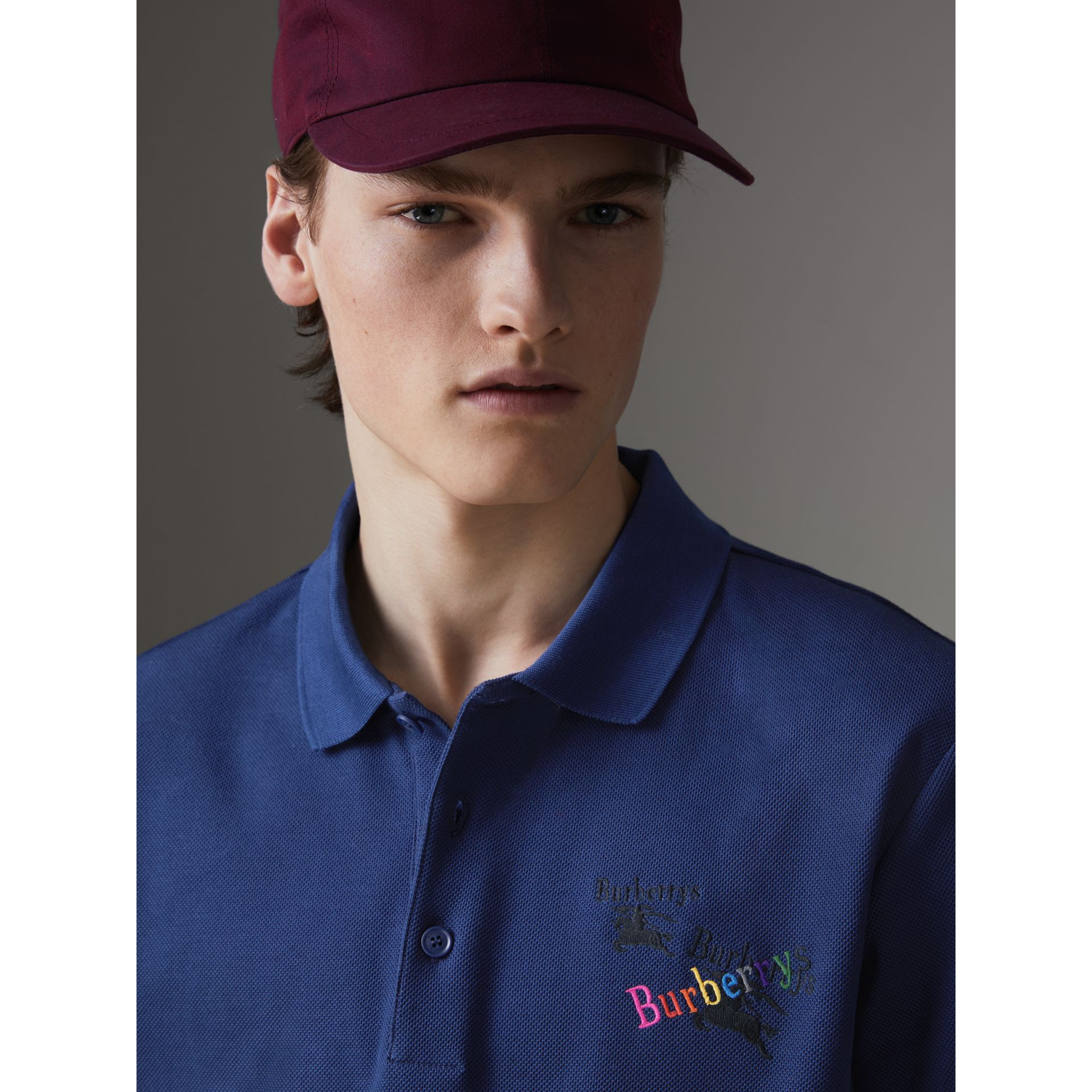 Triple Archive Logo Cotton Piqué Polo Shirt in Bright Indigo - Men | Burberry Canada - gallery image 1