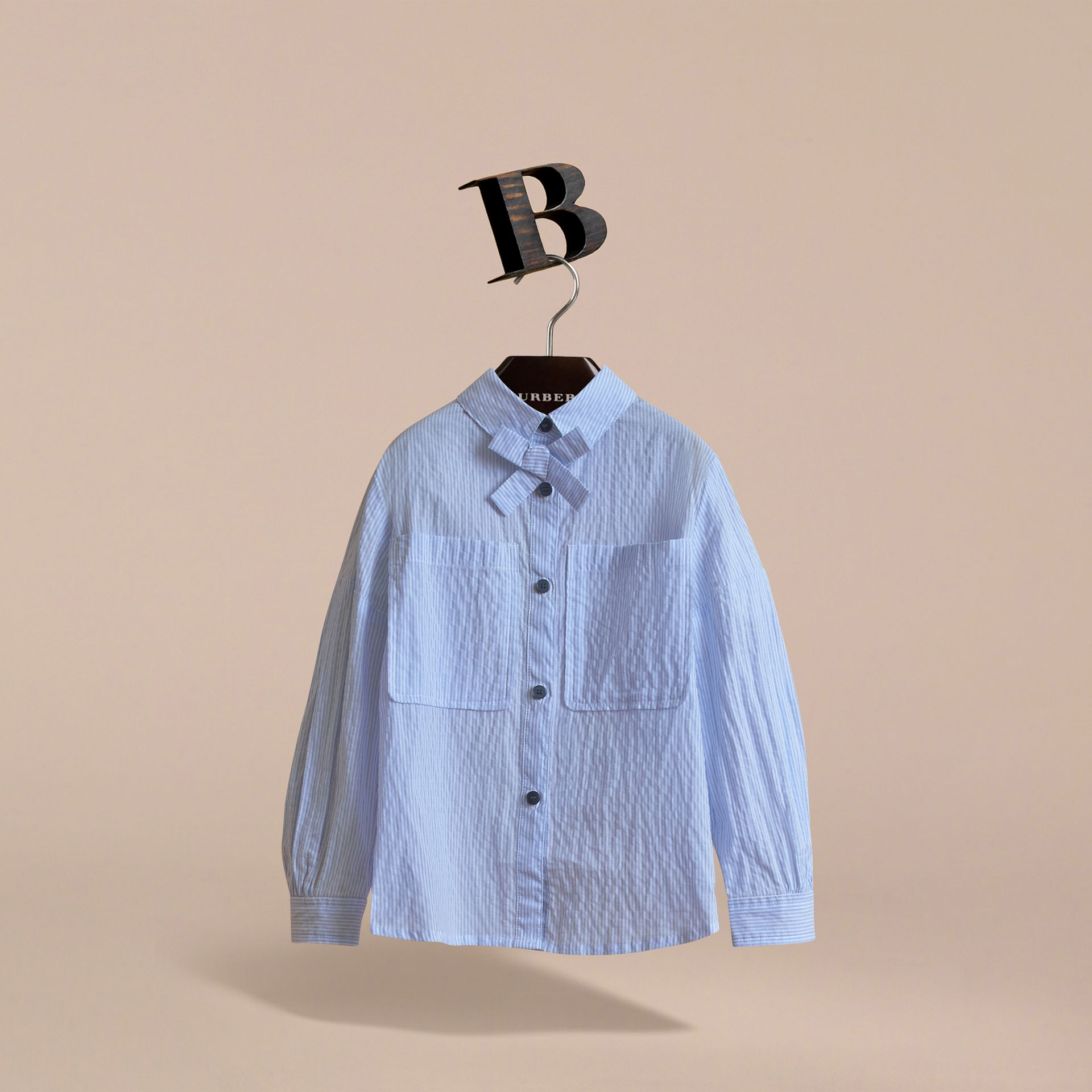 Bow Detail Striped Cotton Seersucker Shirt in Light Blue - Girl | Burberry - gallery image 3