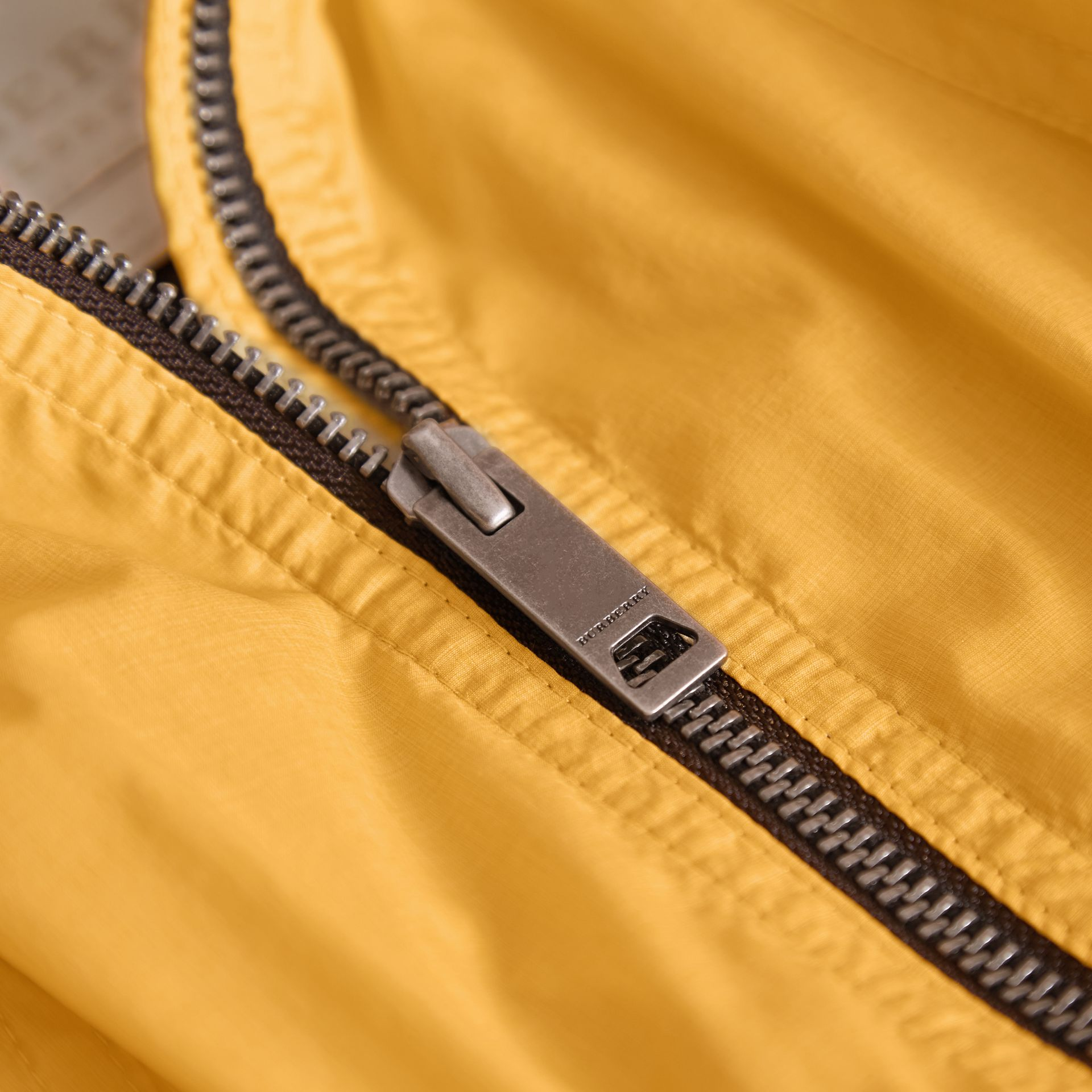 Packaway Hood Showerproof Jacket with Check Detail in Gorse Yellow - Girl | Burberry - gallery image 2
