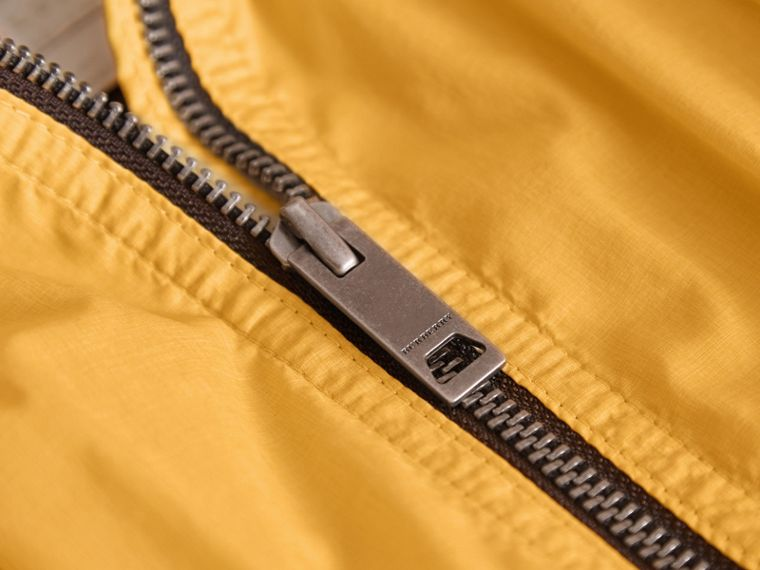 Packaway Hood Showerproof Jacket with Check Detail in Gorse Yellow - Girl | Burberry - cell image 1