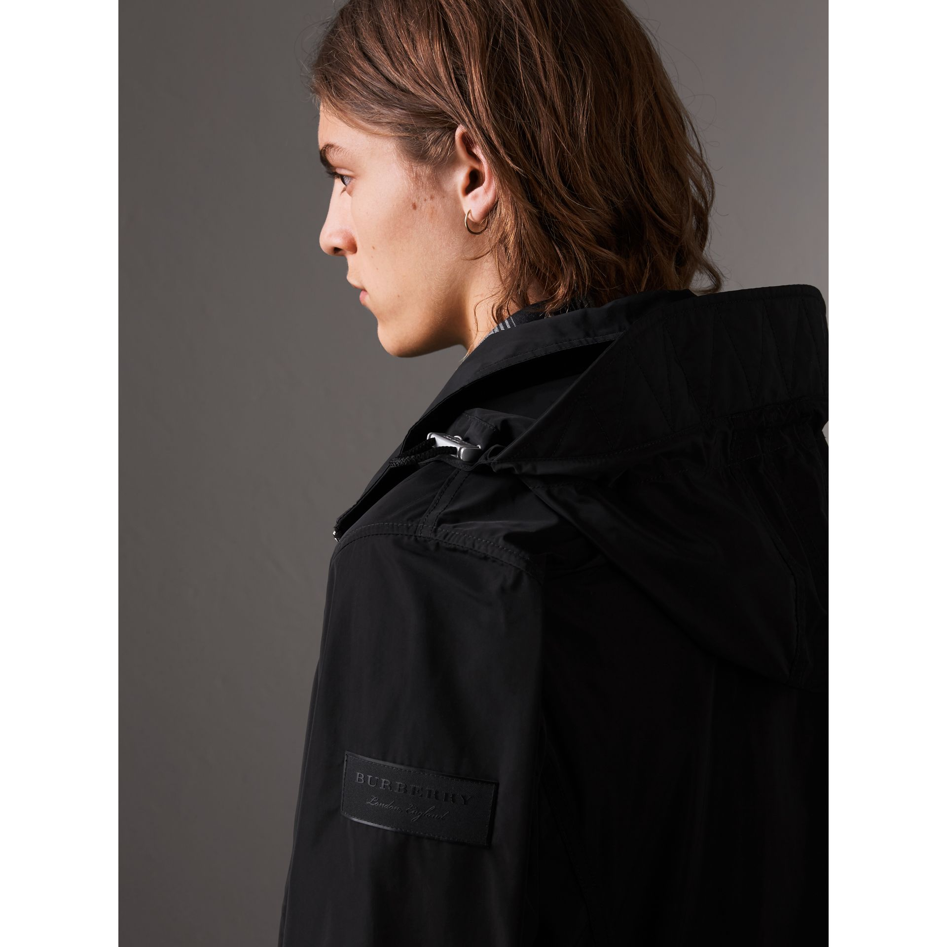 Packaway Hood Showerproof Jacket in Black - Men | Burberry United Kingdom - gallery image 1