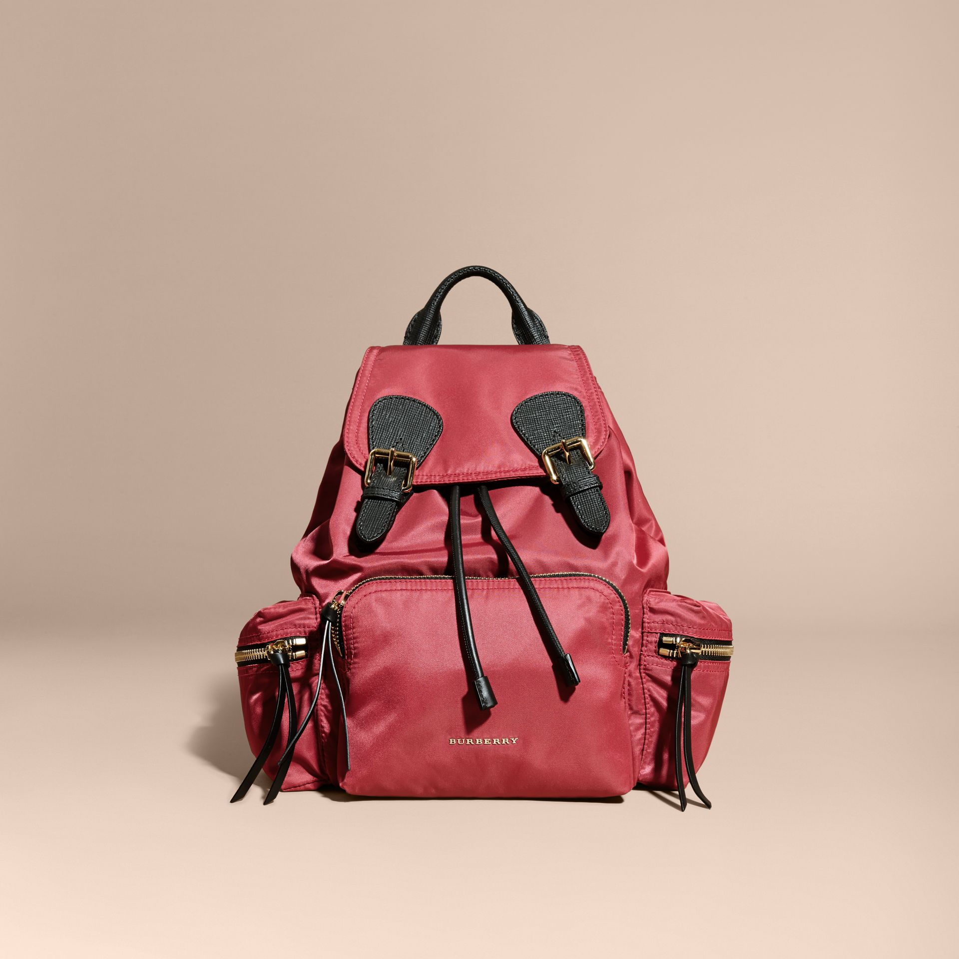 The Medium Rucksack in Technical Nylon and Leather in Plum Pink - gallery image 9