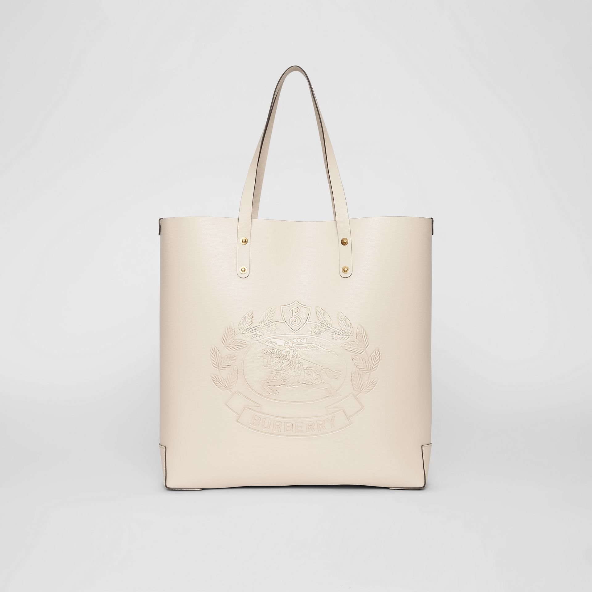Large Embossed Crest Leather Tote in Limestone | Burberry Australia - gallery image 0
