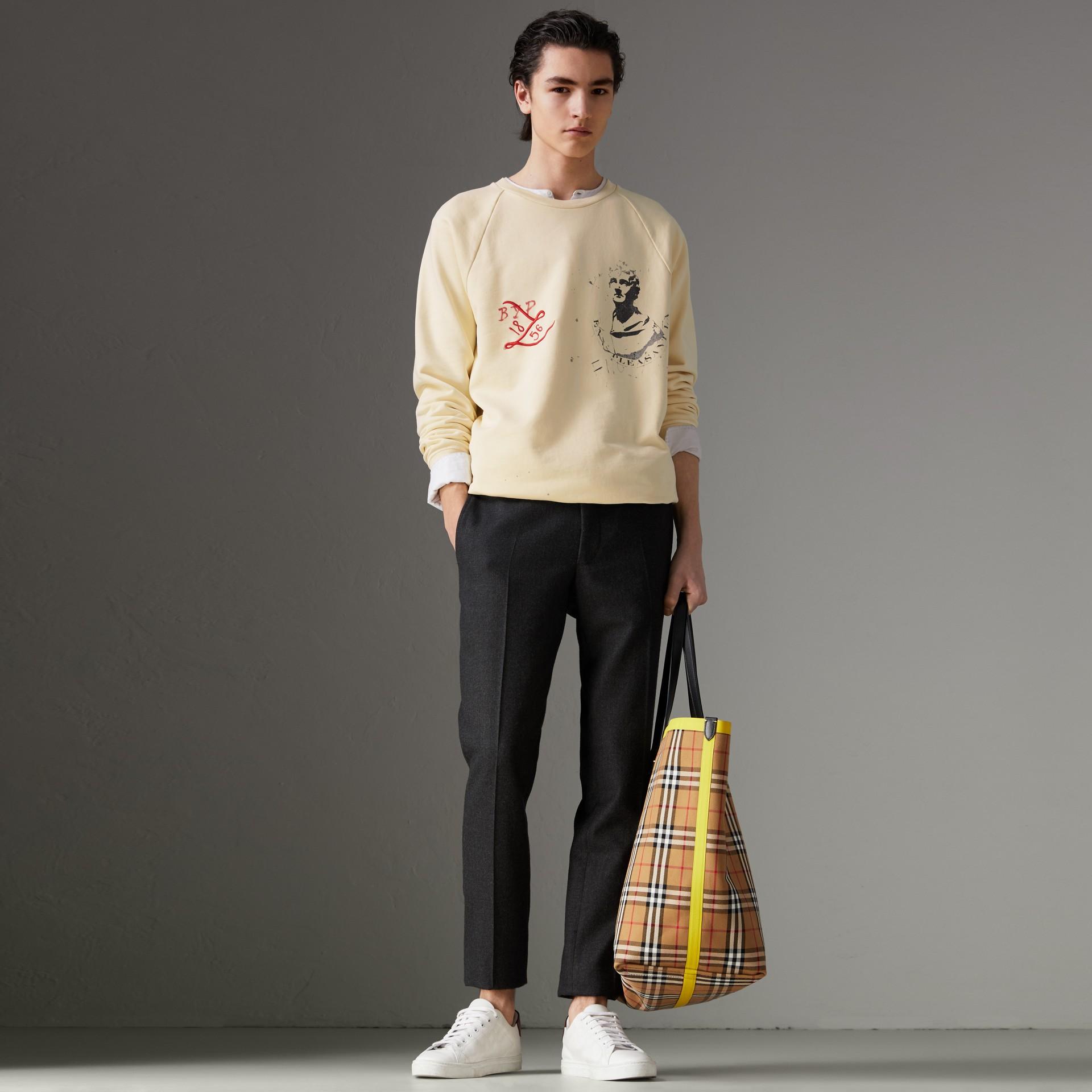 Portrait and Logo Print Cotton Sweatshirt in Pale Yellow - Men | Burberry United Kingdom - gallery image 0