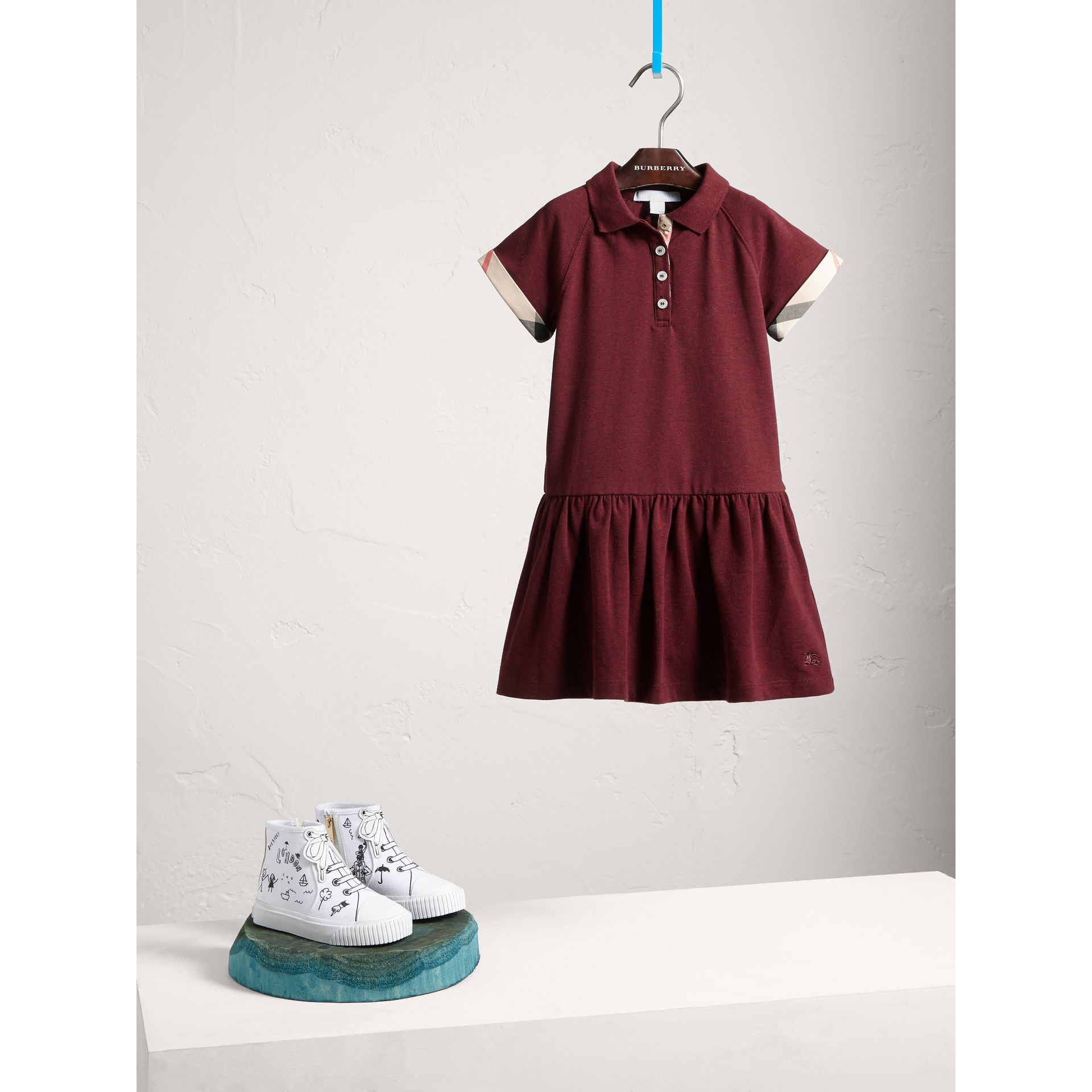 Dropped-waist Stretch Cotton Piqué Dress in Burgundy Melange - Girl | Burberry - gallery image 1