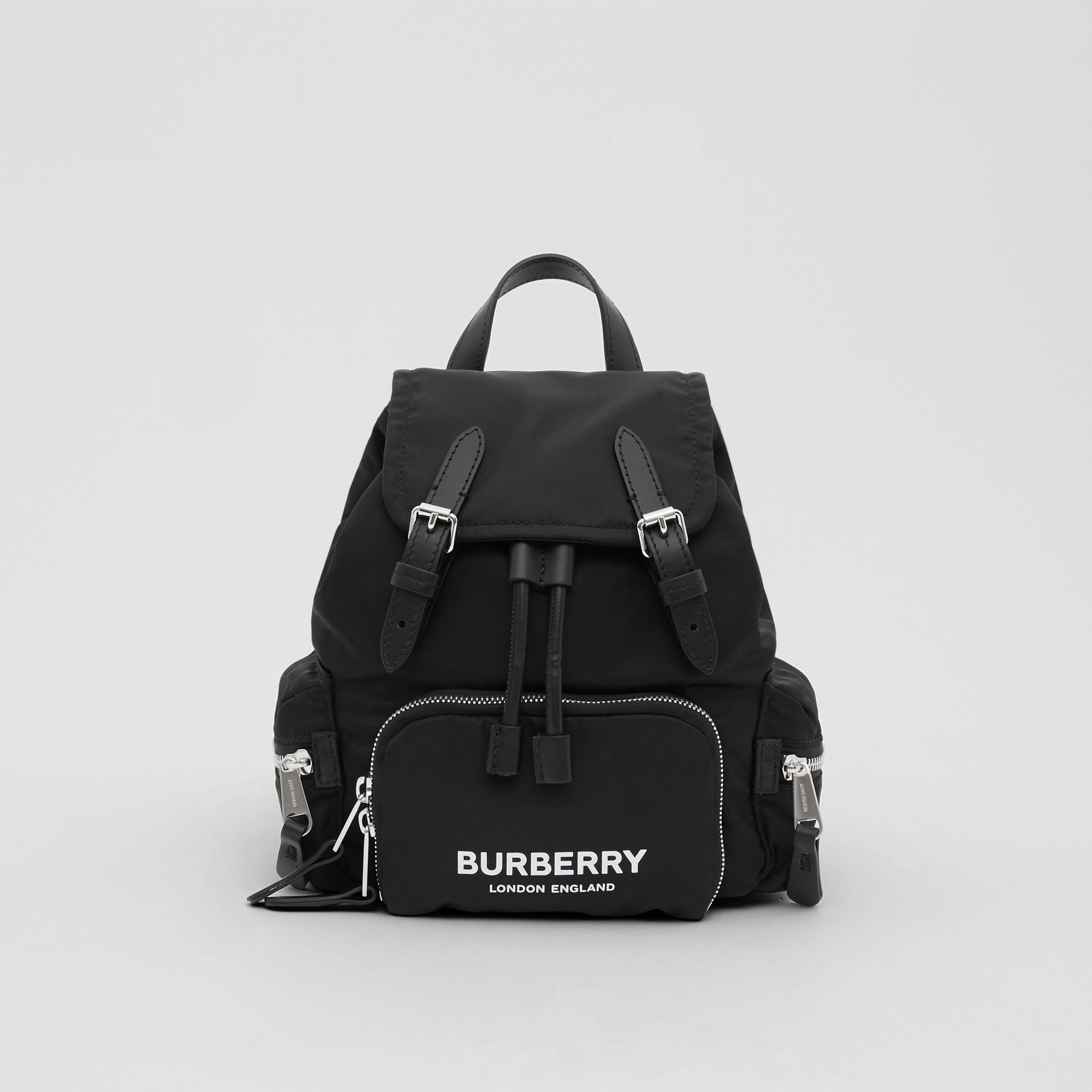 The Small Rucksack in Logo Print ECONYL® in Black - Women | Burberry United Kingdom - gallery image 0