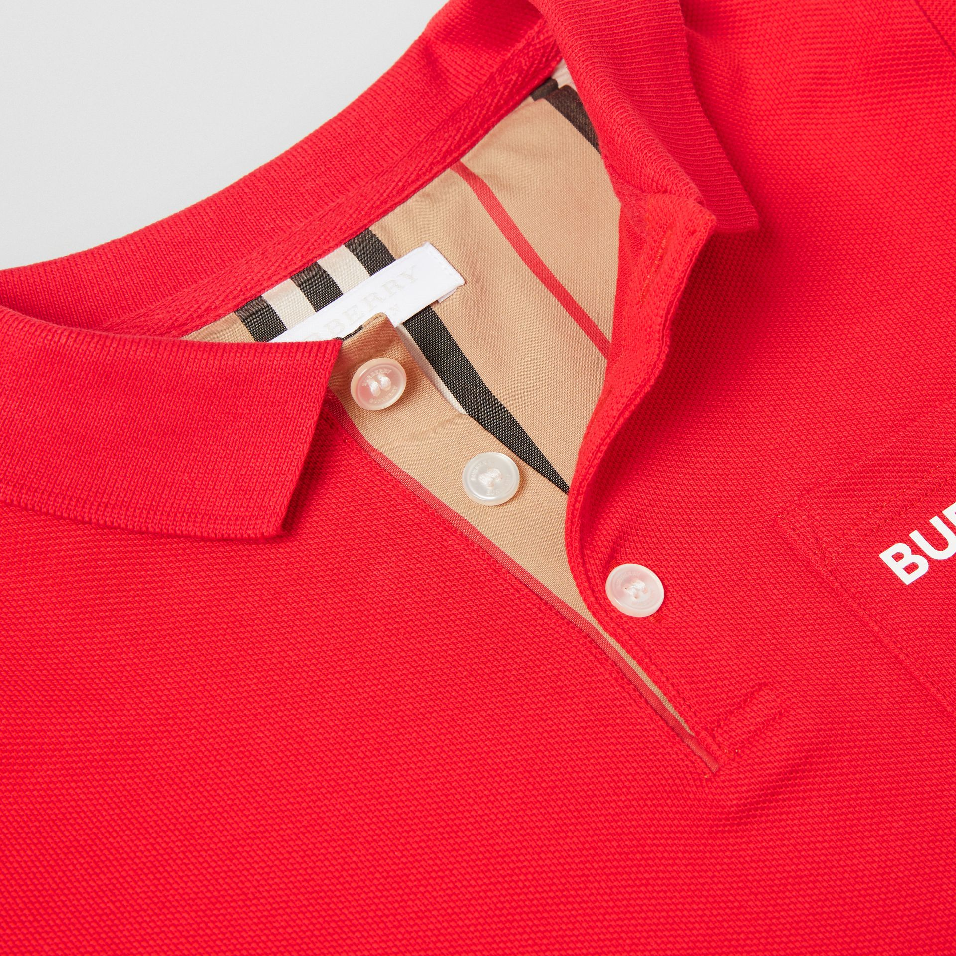 Icon Stripe Placket Cotton Piqué Polo Shirt in Bright Red | Burberry Singapore - gallery image 1