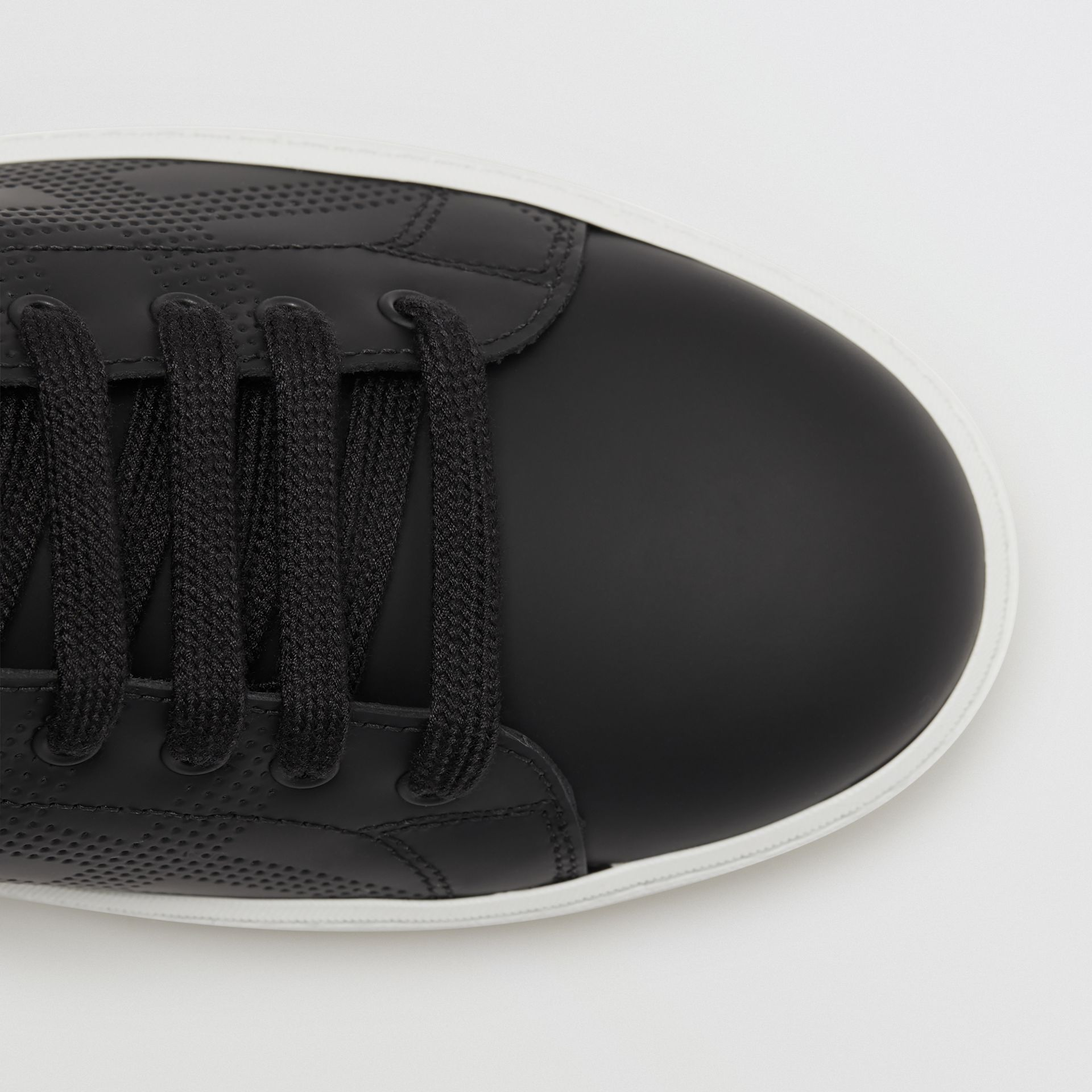 Perforated Check Leather Sneakers in Black - Women | Burberry Canada - gallery image 1