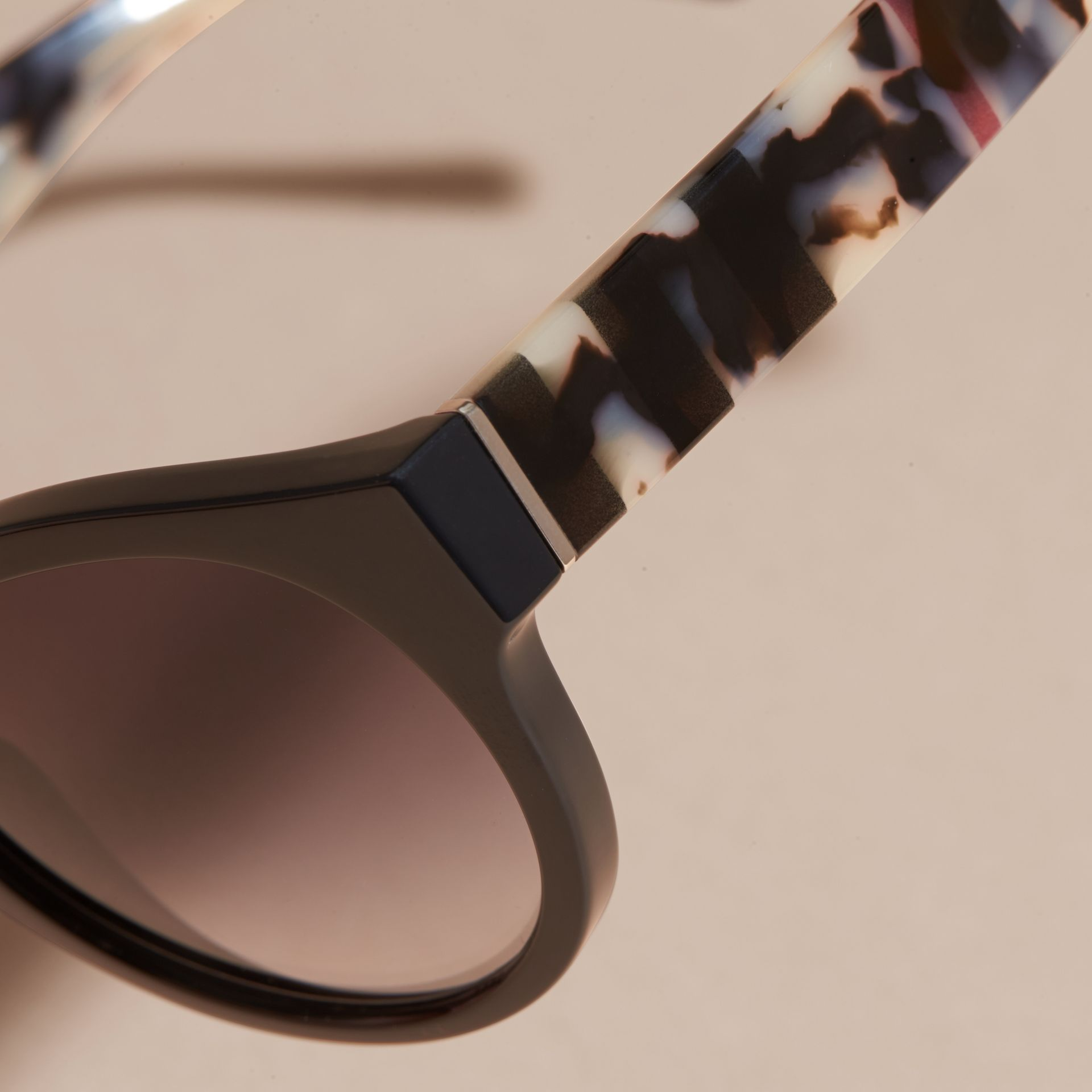 Check and Camouflage Detail Round Frame Sunglasses in Black - Women | Burberry - gallery image 2