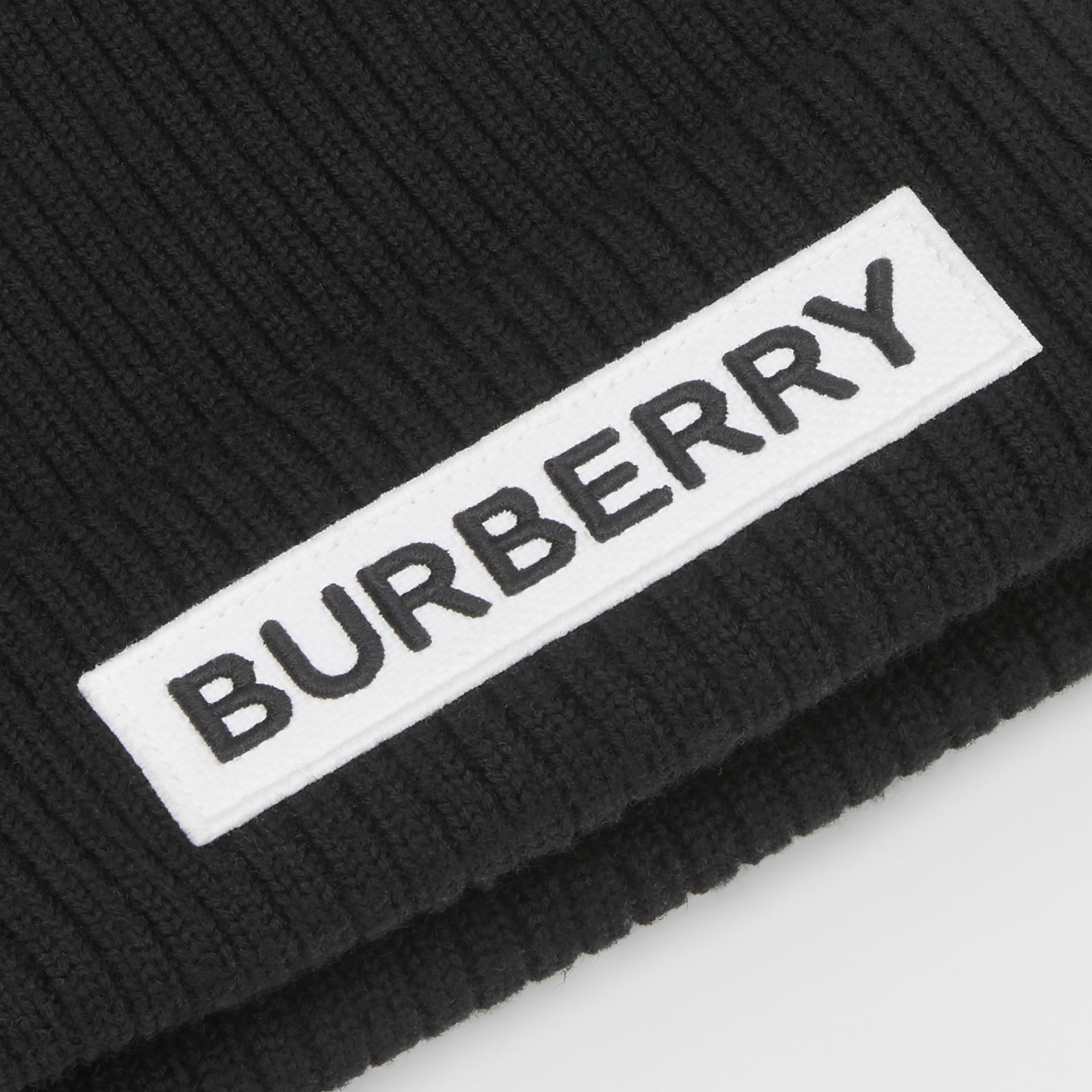 Logo Detail Rib Knit Merino Wool Beanie in Black - Children | Burberry Australia - gallery image 1