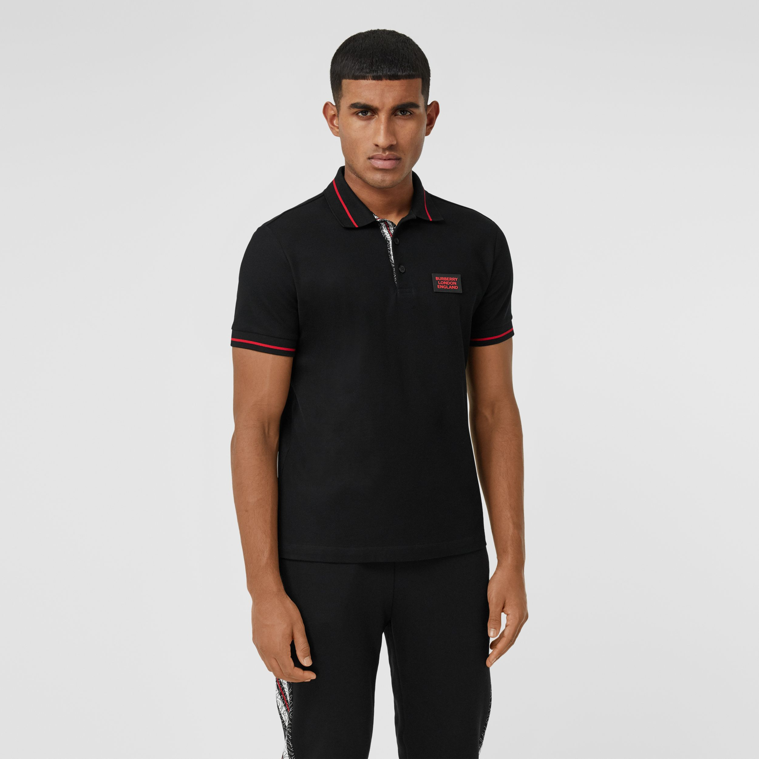 Logo Appliqué Cotton Piqué Polo Shirt in Black - Men | Burberry - 1
