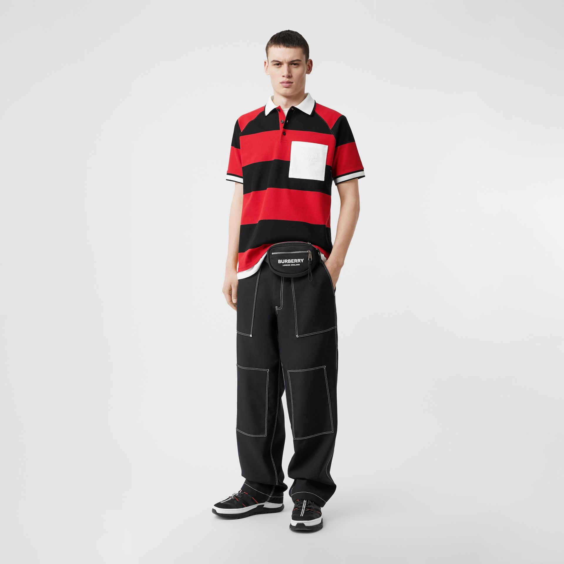 Striped Cotton Piqué Oversized Polo Shirt in Black/bright Red - Men | Burberry Hong Kong S.A.R - gallery image 0