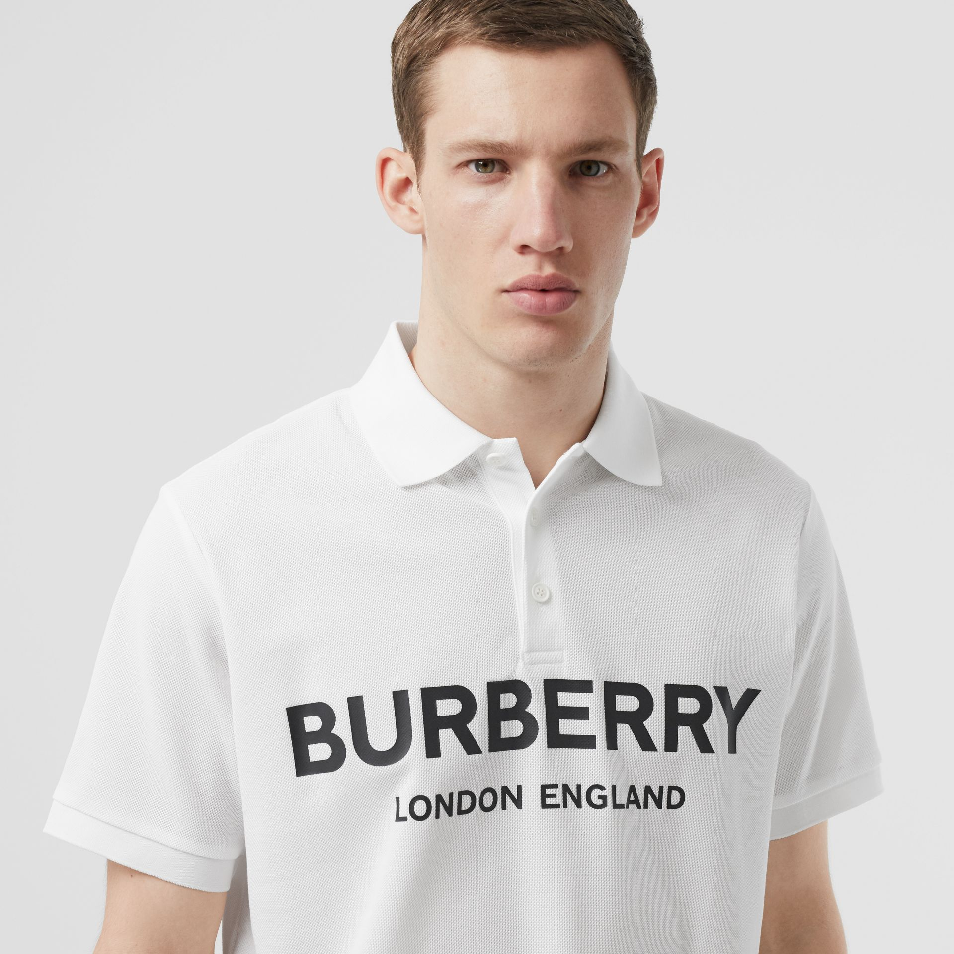 Logo Print Cotton Piqué Polo Shirt in White - Men | Burberry - gallery image 1
